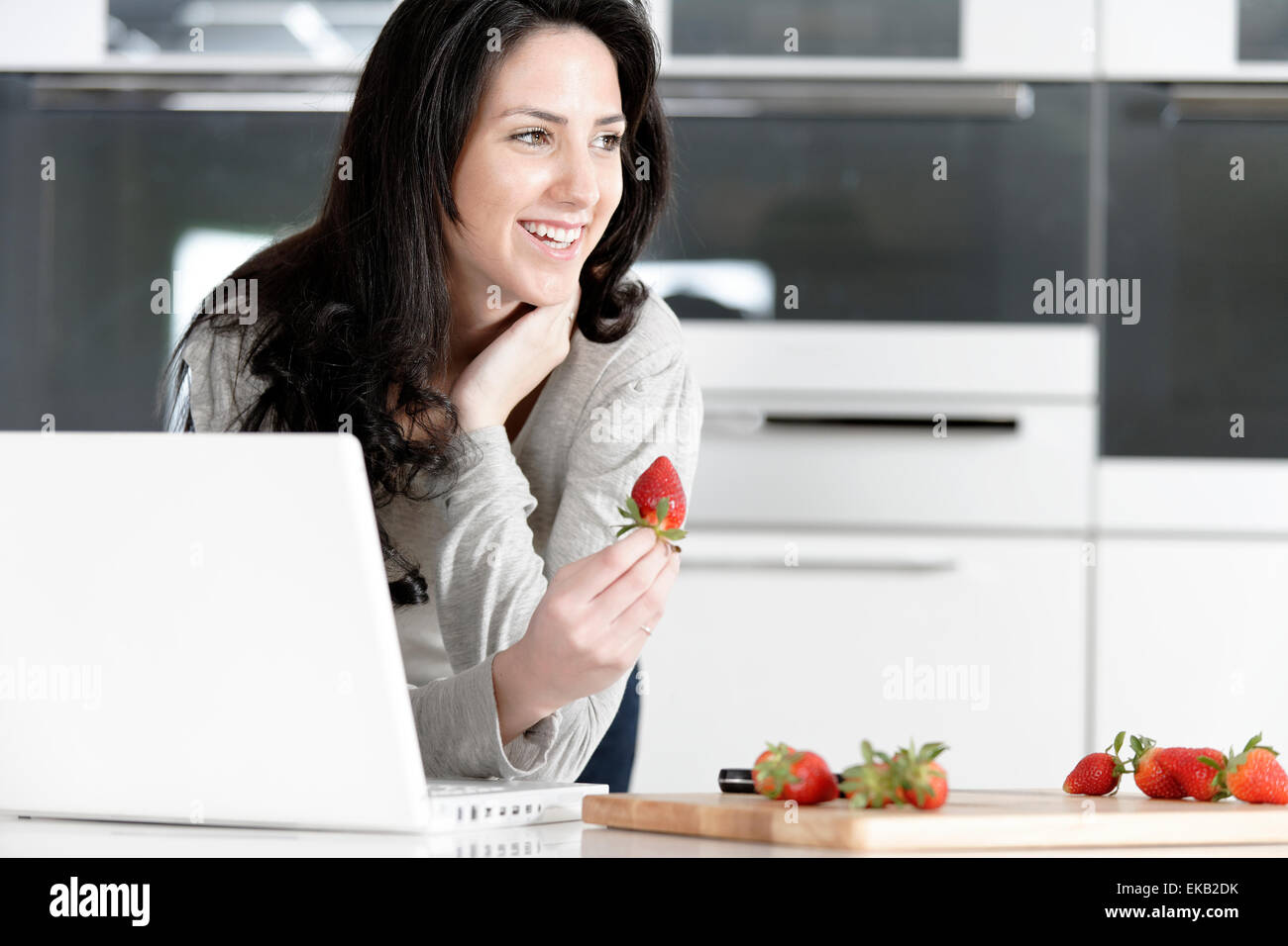Woman in kitchen reading recipe Stock Photo: 80763359 - Alamy