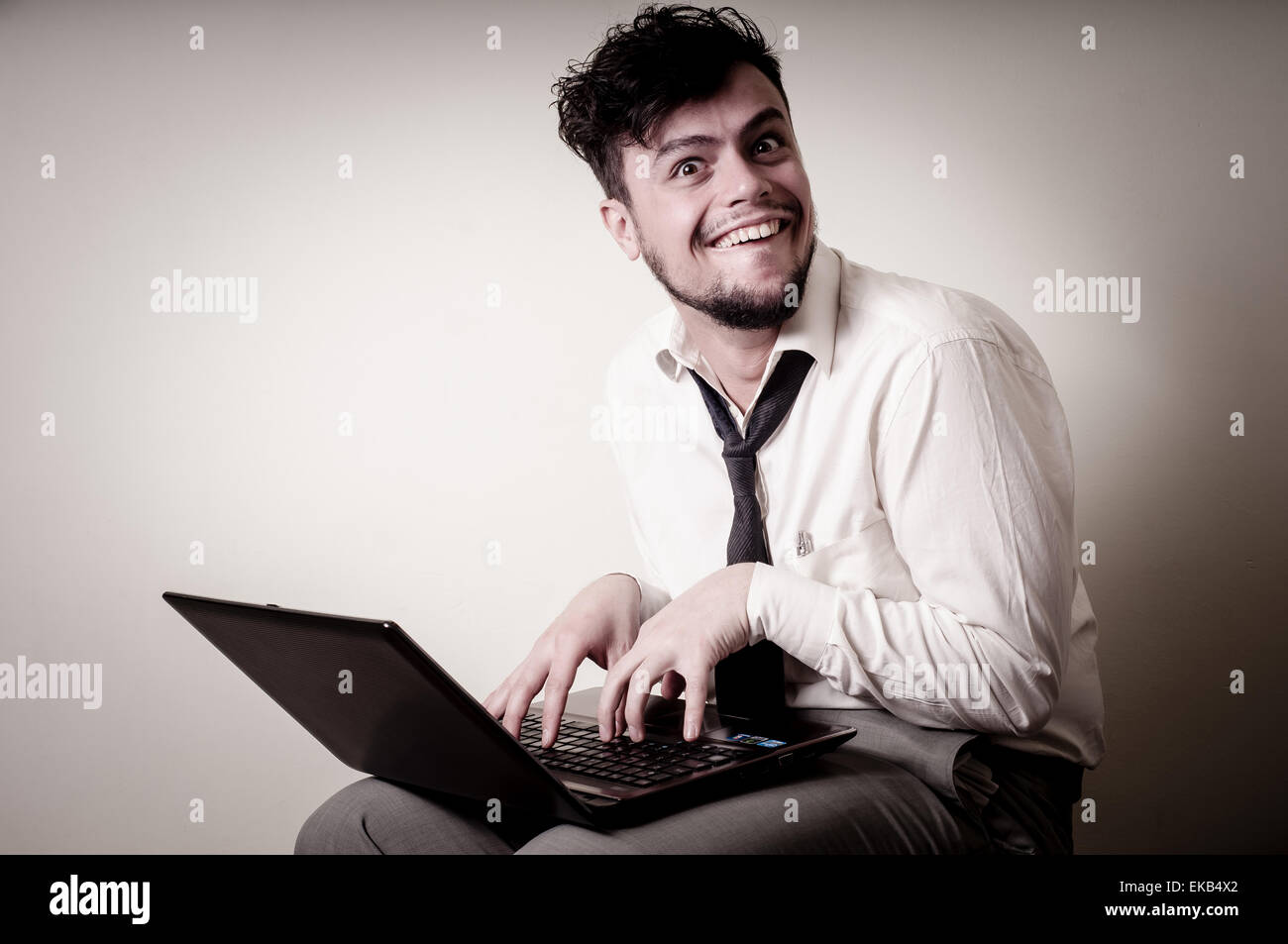 funny businessman using notebook - Stock Image