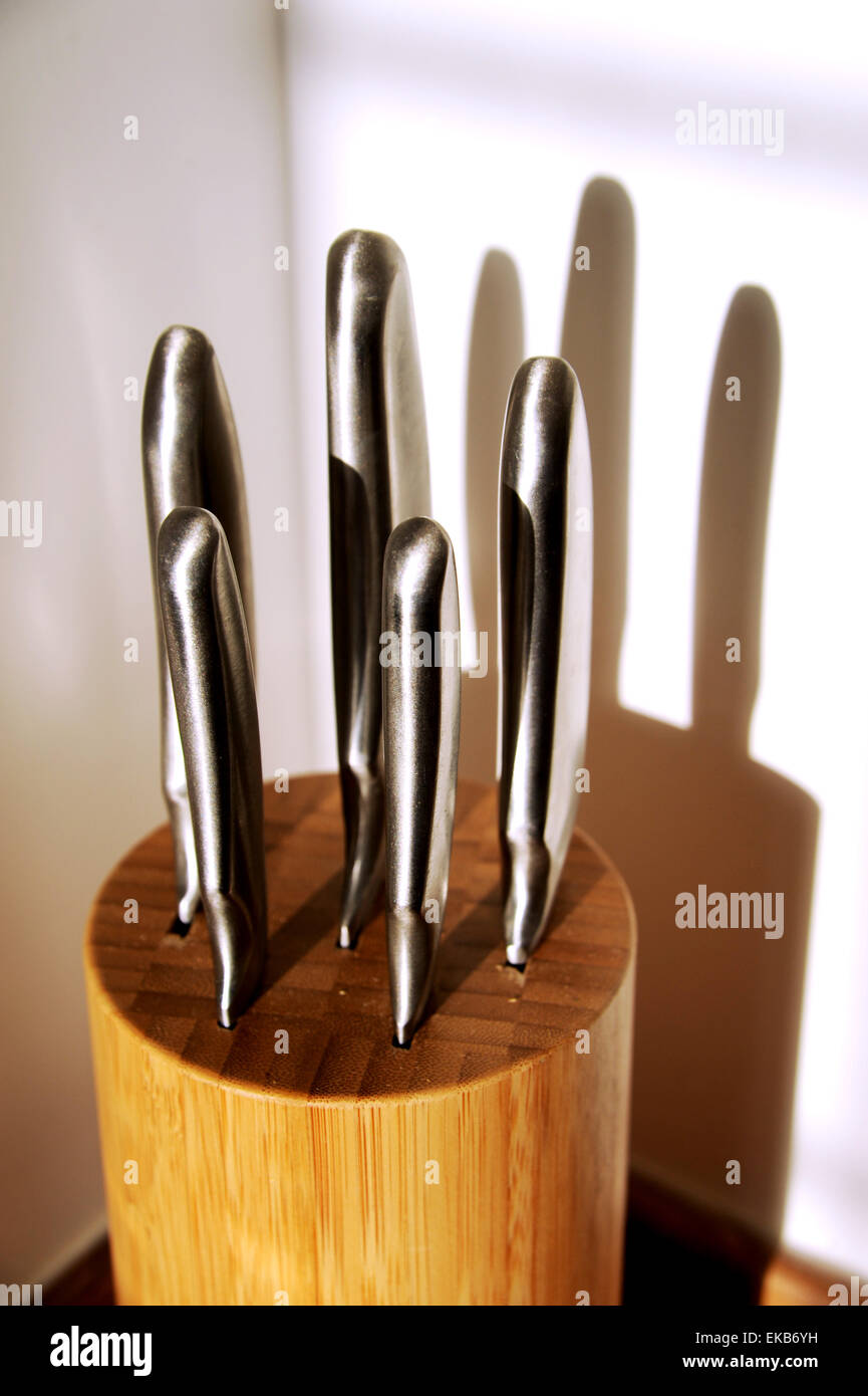 Sharp Knives In A Wooden Knife Block In Domestic Kitchen Bought From