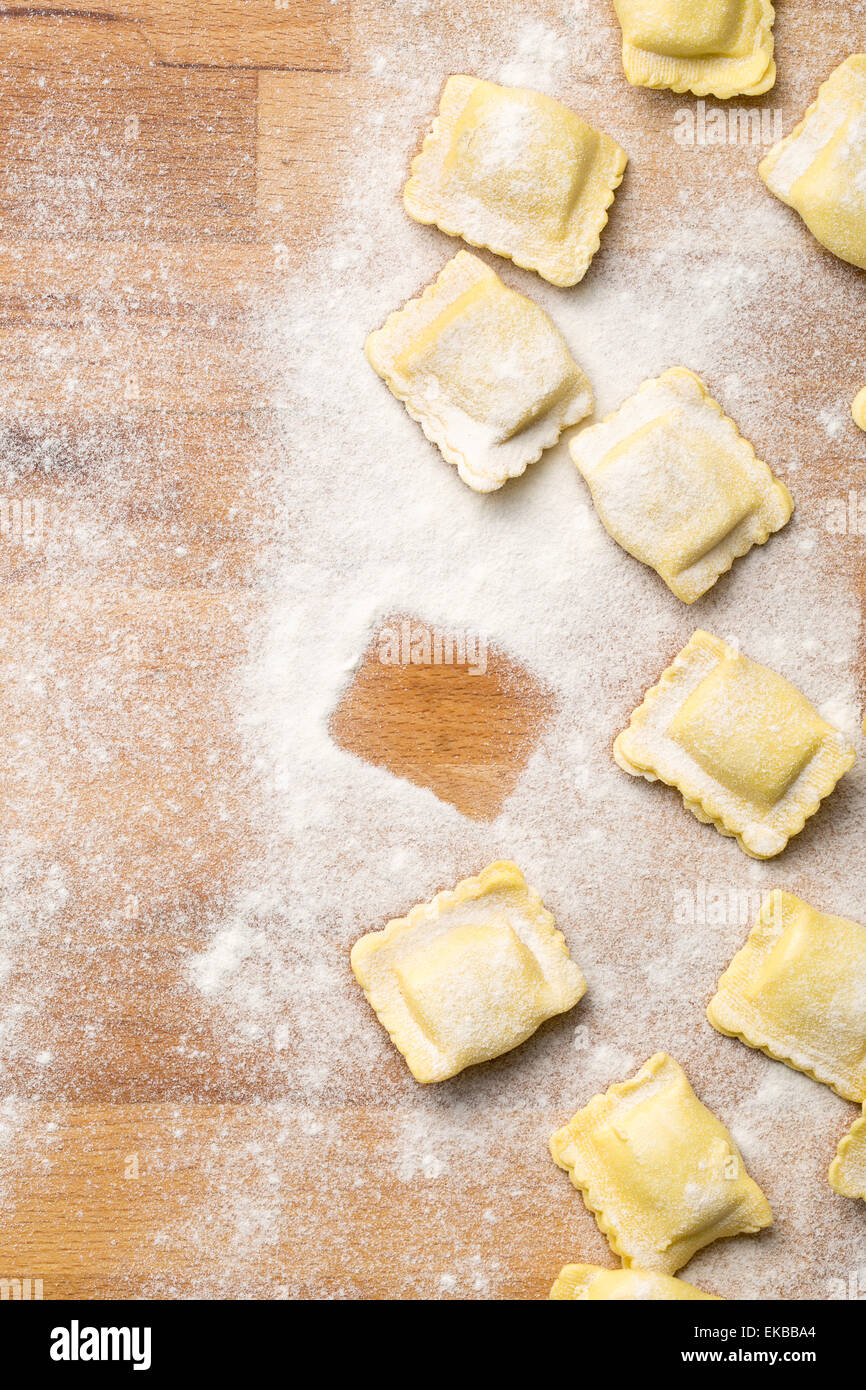 ravioli pasta on kitchen table - Stock Image