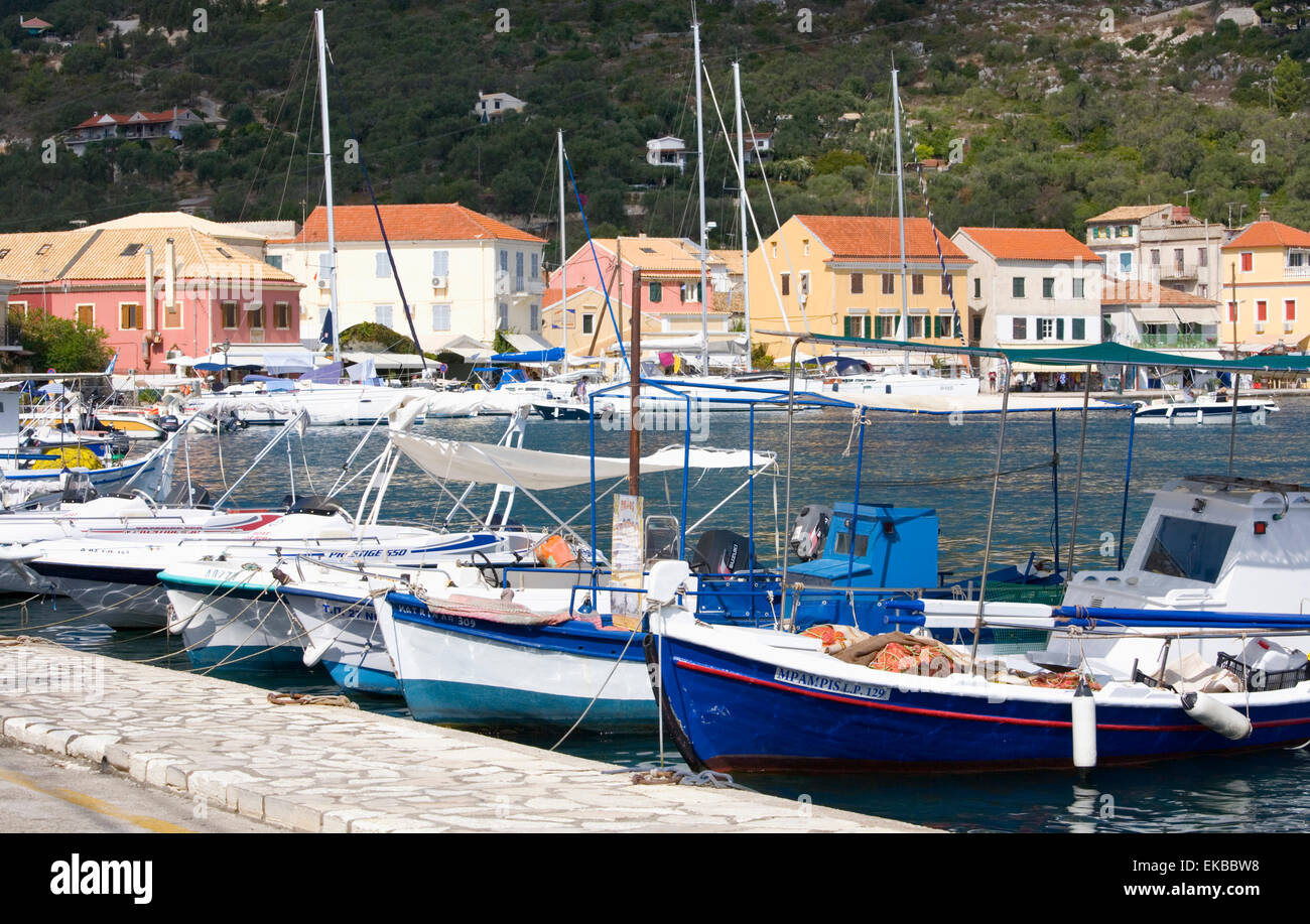 View across the harbour to colourful waterfront buildings, Gaios, Paxos, Paxi, Corfu, Ionian Islands, Greek Islands, - Stock Image