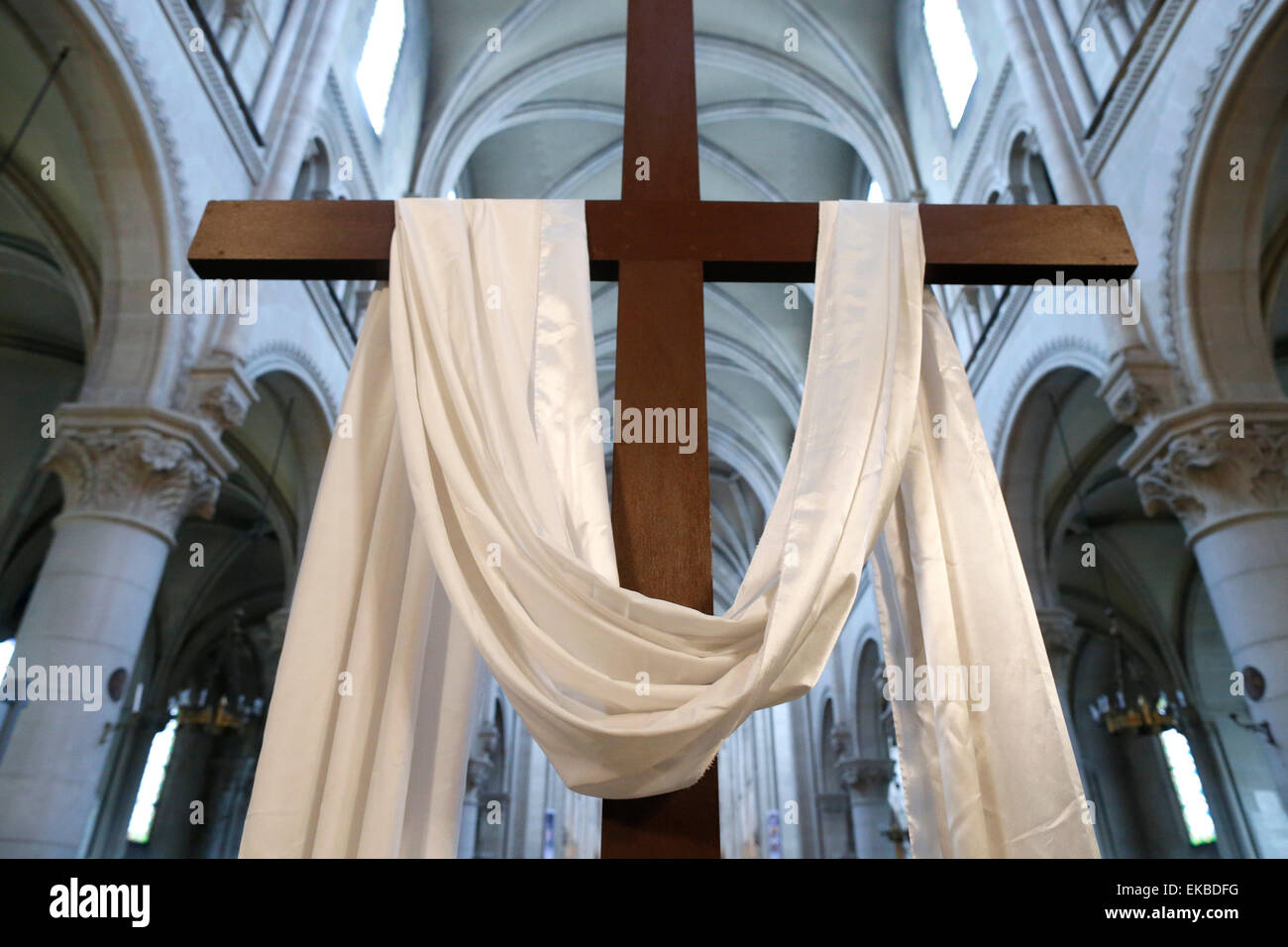 The cross and the white cloth symbolize the resurrection of Jesus, Holy Week, St. Ambroise church, Paris, France, - Stock Image