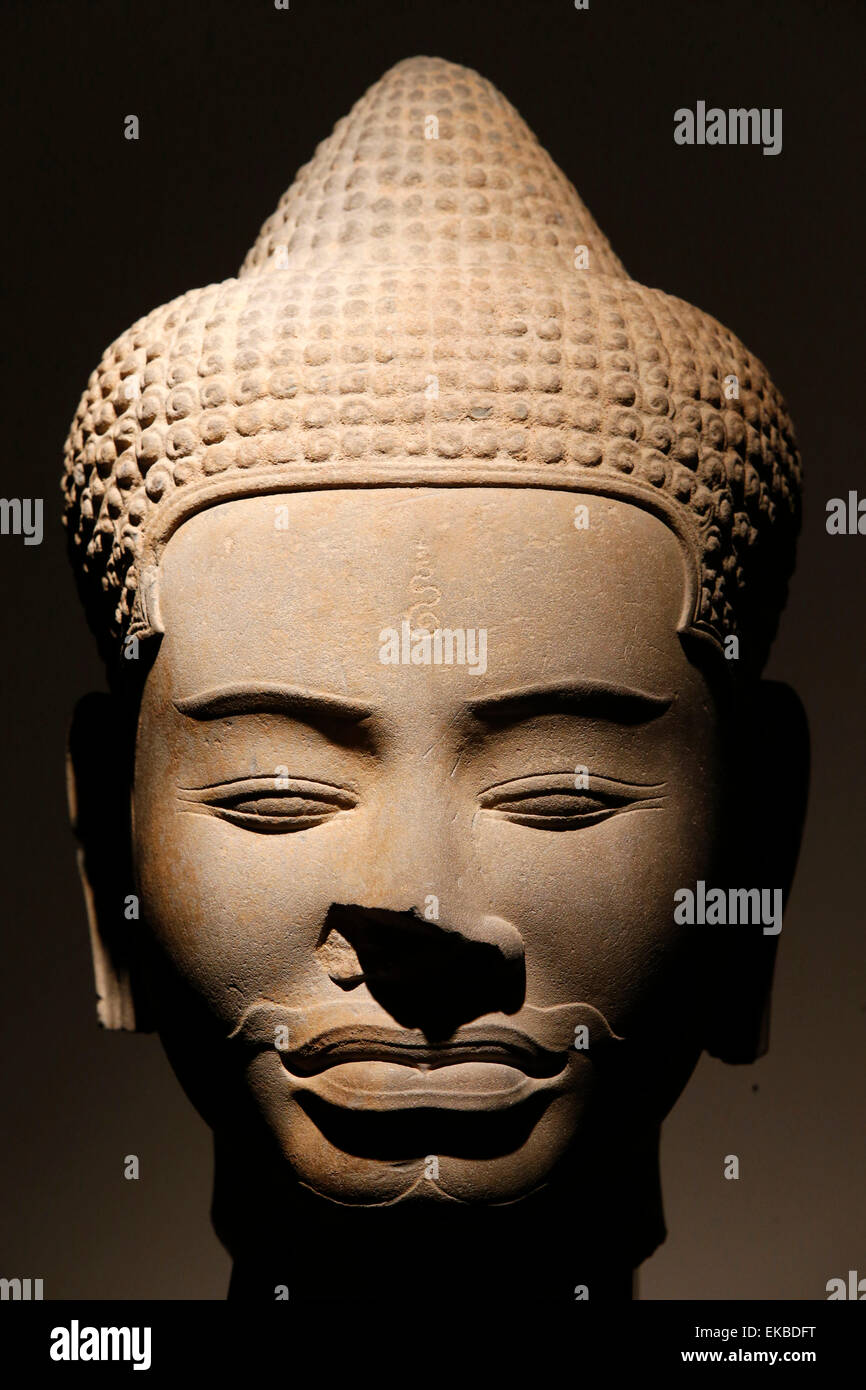 Sandstone head, Baphuon style dating from the 11th century from Siem Reap, Cambodia, Guimet Museum, Paris, France, - Stock Image