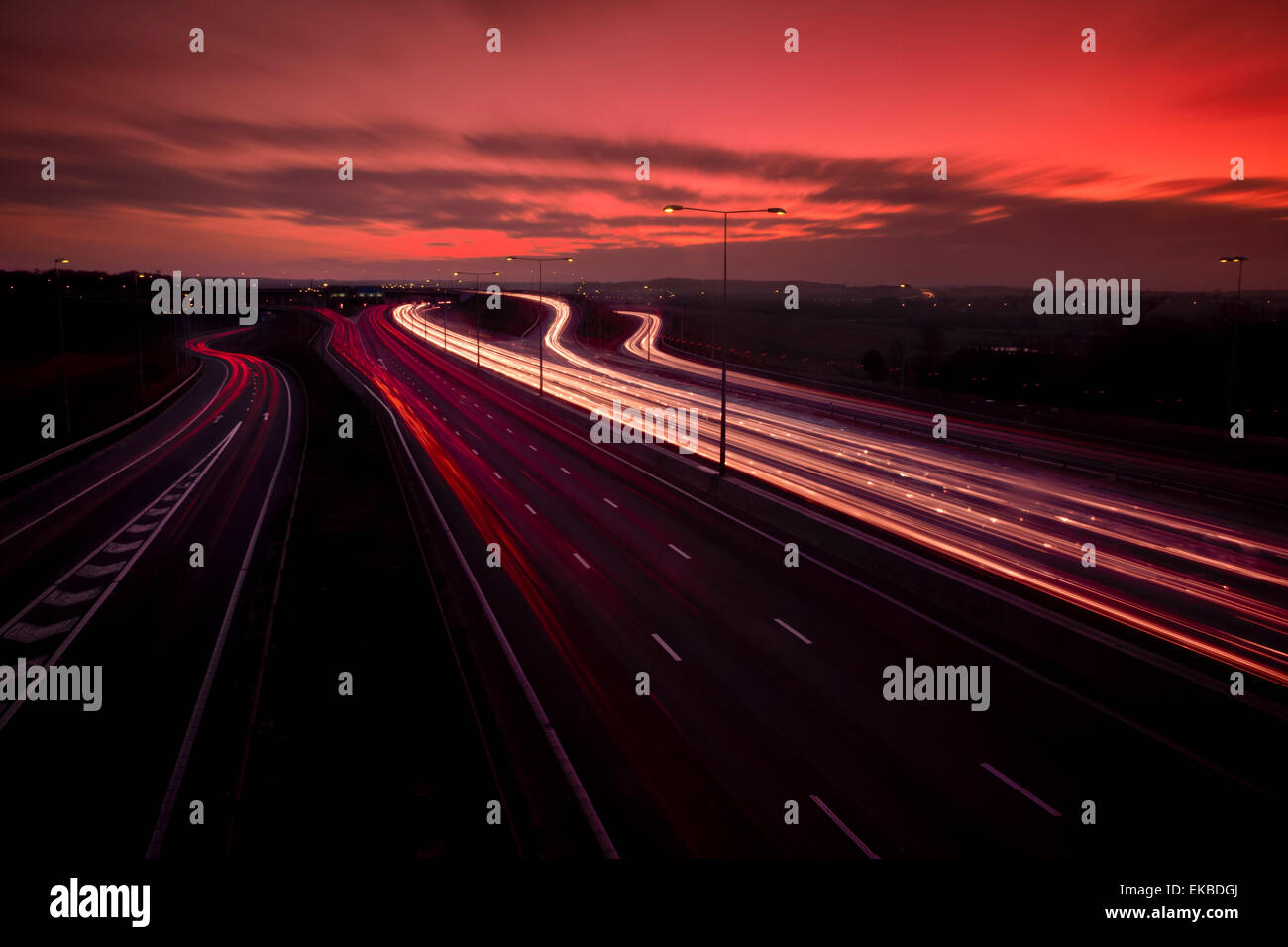 M25 motorway light trails at Dartford Crossing under dramatic sky, Kent, England, United Kingdom, Europe - Stock Image