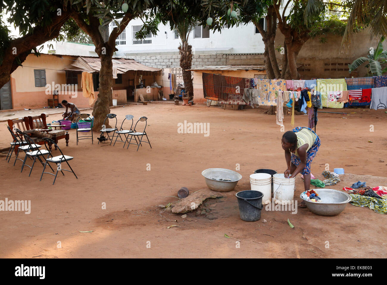 African woman doing the dishes, Lome, Togo, West Africa, Africa - Stock Image