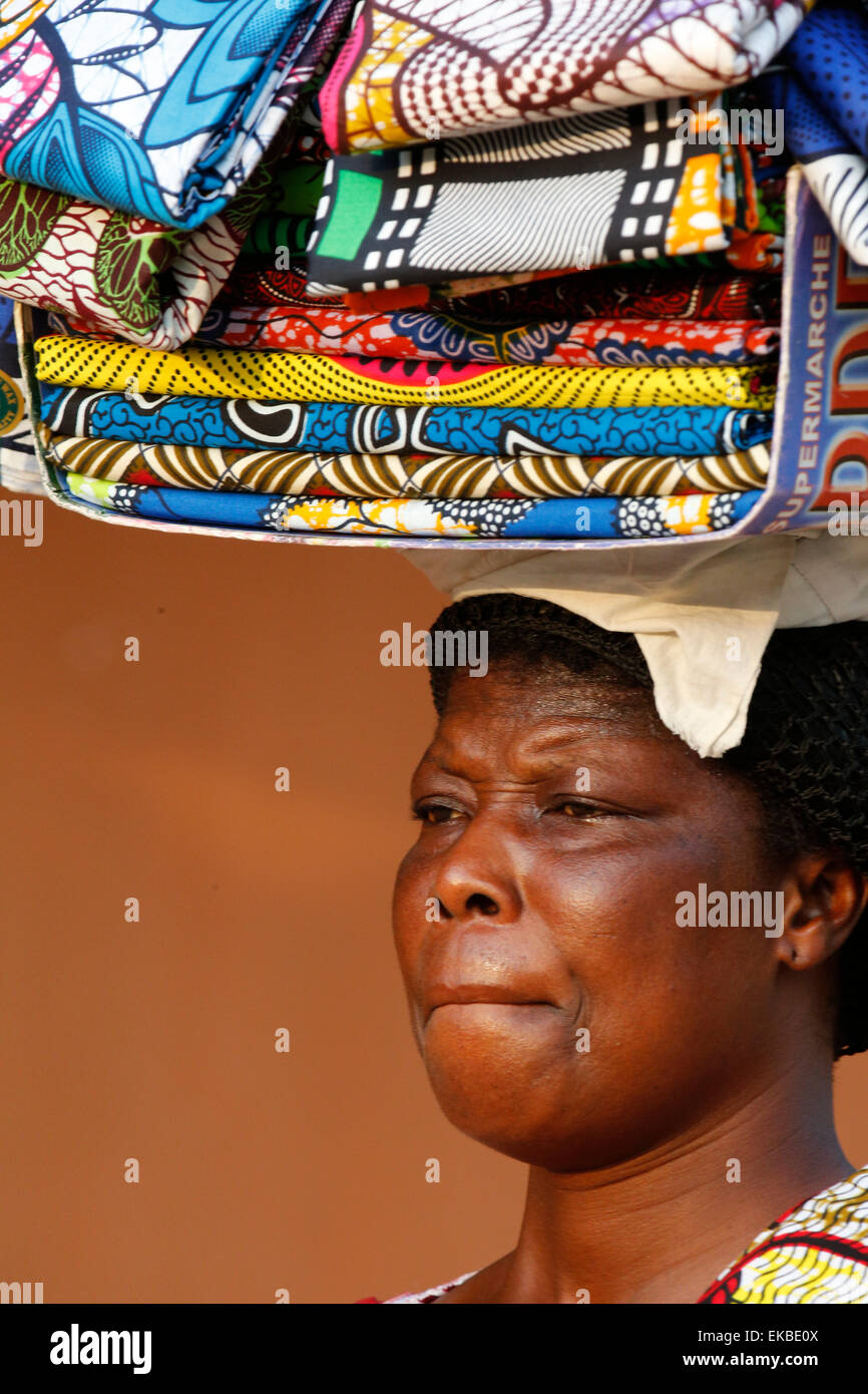 Street vendor selling African cloths, Lome, Togo, West Africa, Africa - Stock Image