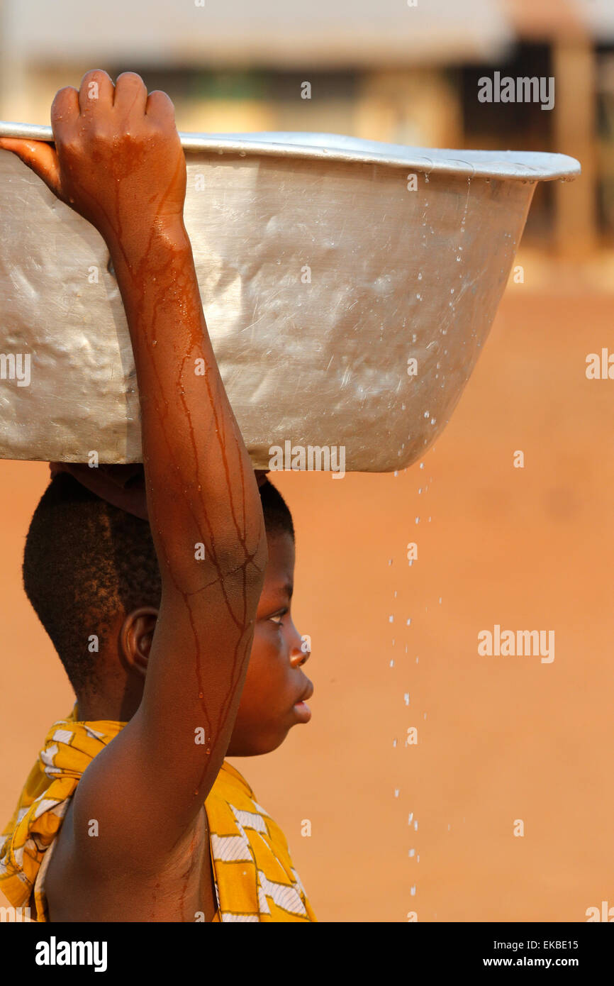 Water chore in an African village, Togo, West Africa, Africa - Stock Image