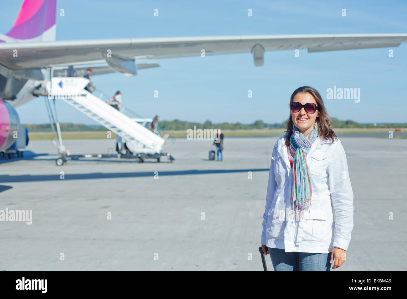 beautiful woman tourist prepared to fly - Stock Image
