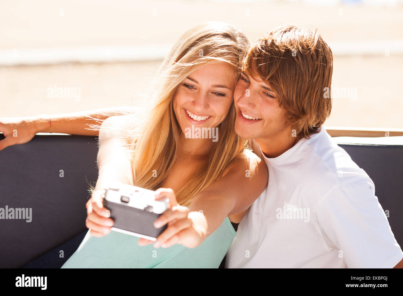 Young beautiful couple taking selfportrait - Stock Image