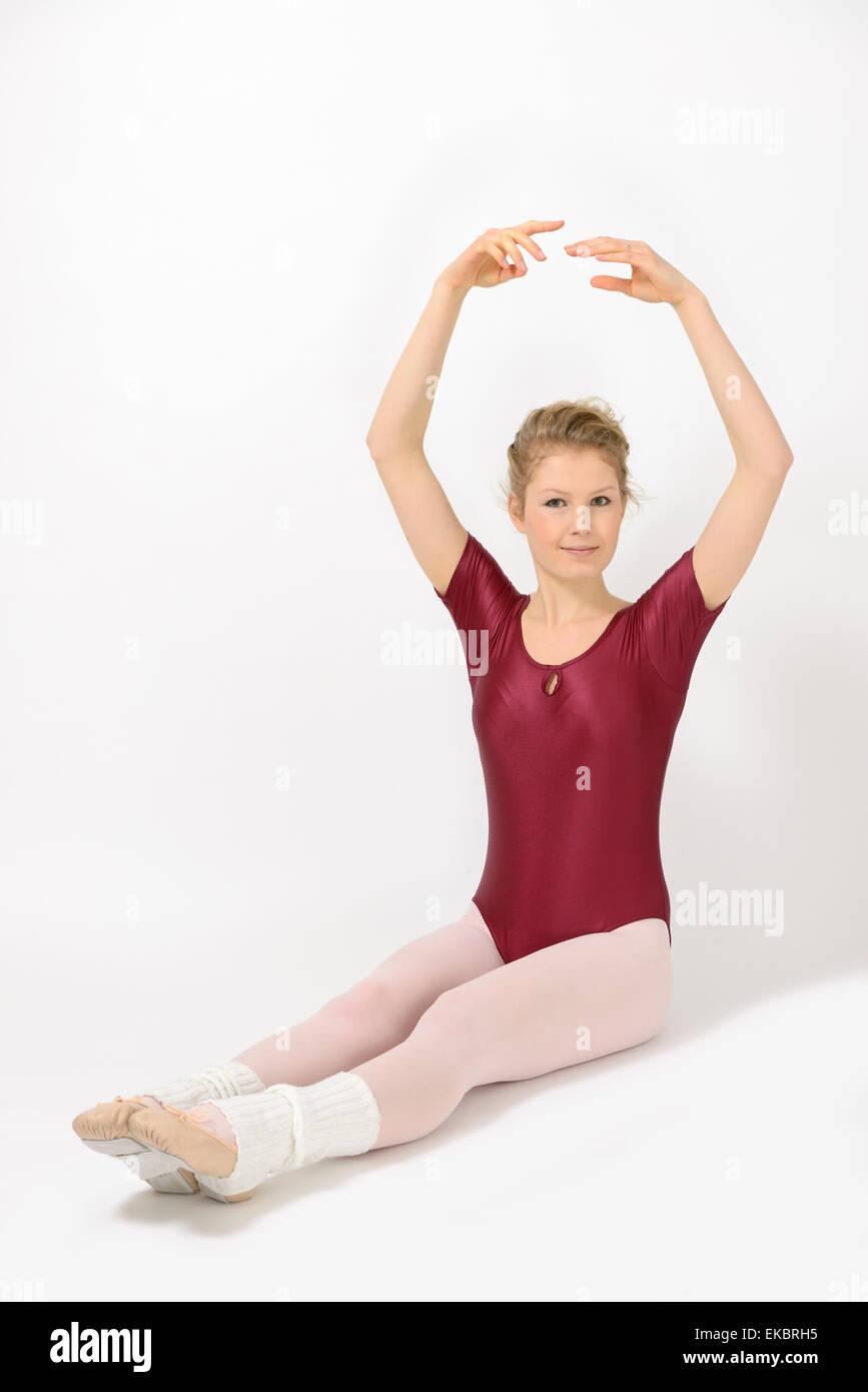 4b380e80e5494 Ballett girl wearing leotard and tights doing basic exercises Stock ...