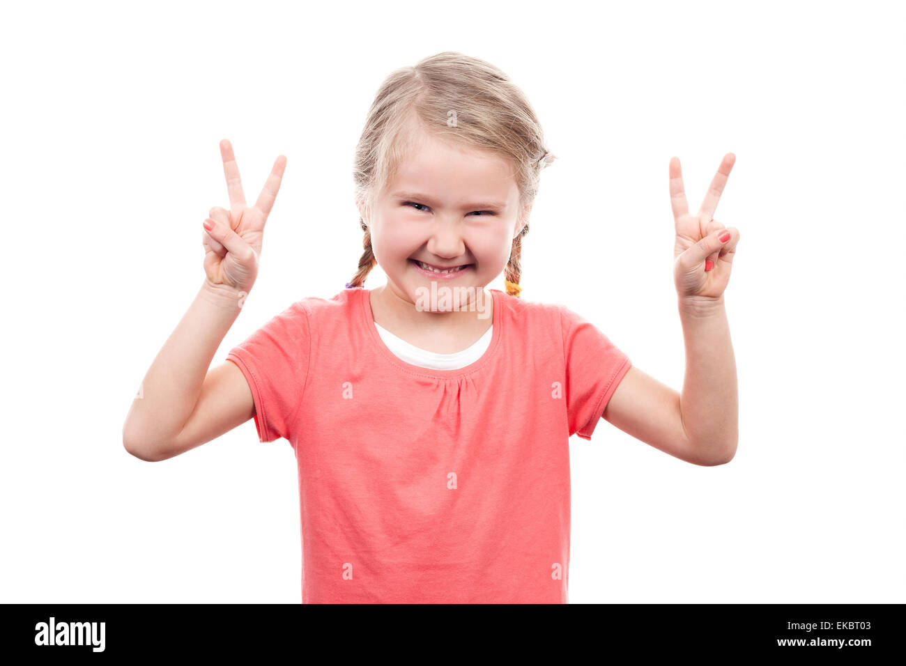 cute girl showing victory sign Stock Photo