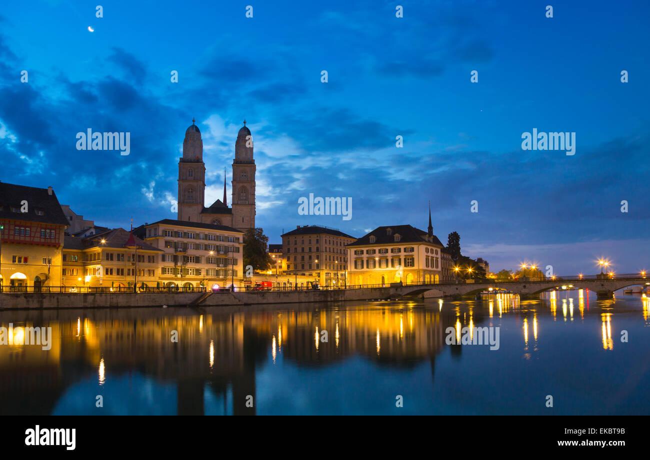 Grossmünster Cathedral, Limmat river by night, Zurich, Switzerland - Stock Image