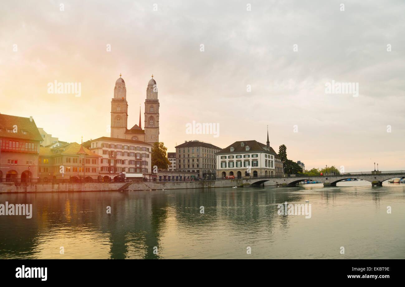 Grossmünster Cathedral, Limmat river by day, Zurich, Switzerland - Stock Image