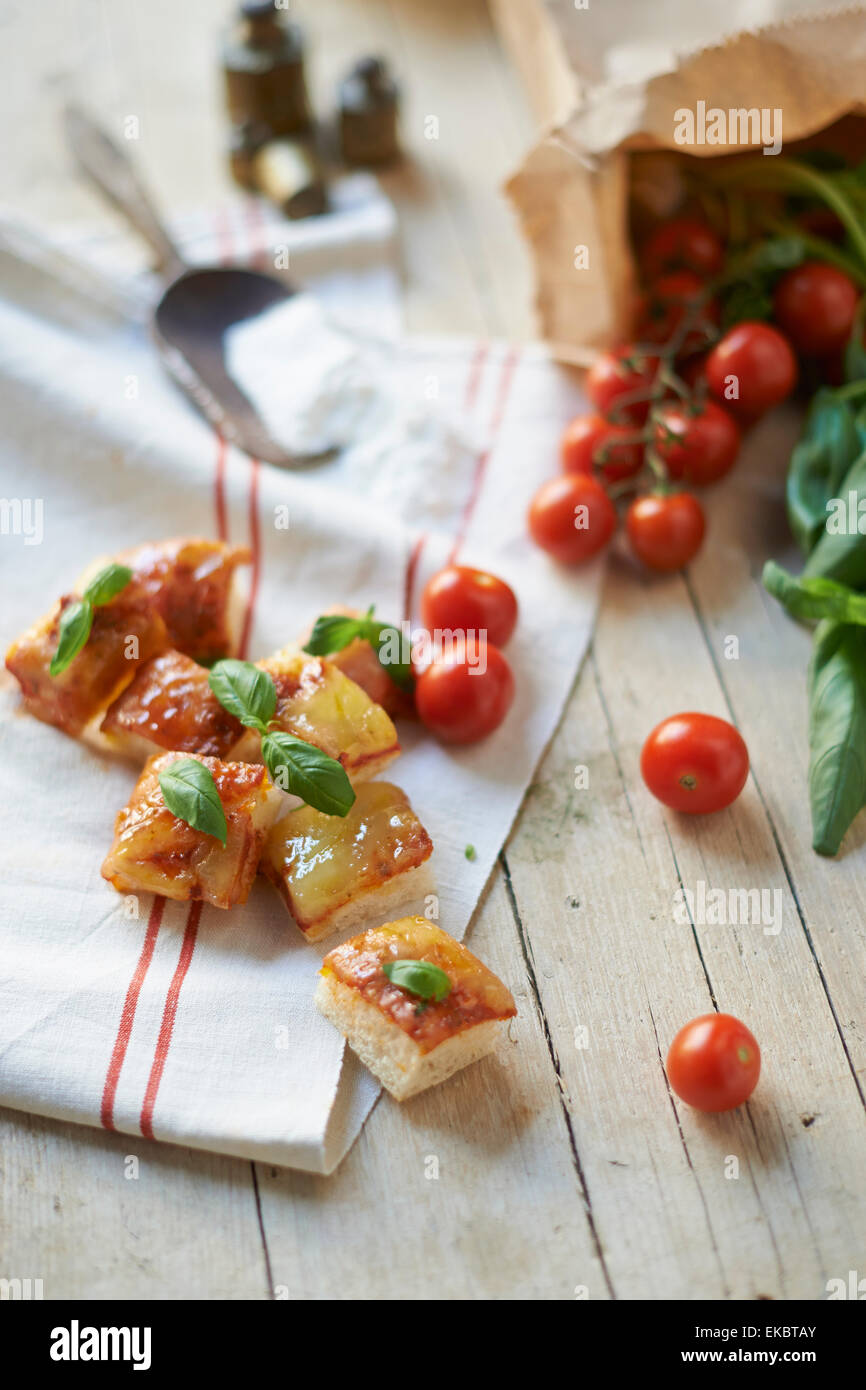 Gluten-free ciabatta squares with vine tomatoes - Stock Image