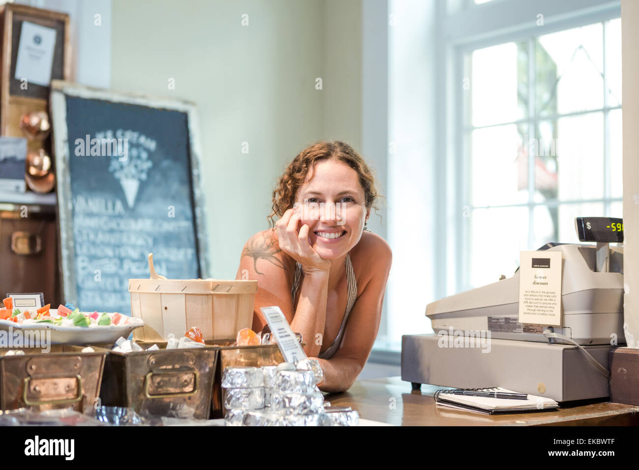 Portrait of female shop keeper in ice cream shop - Stock Image
