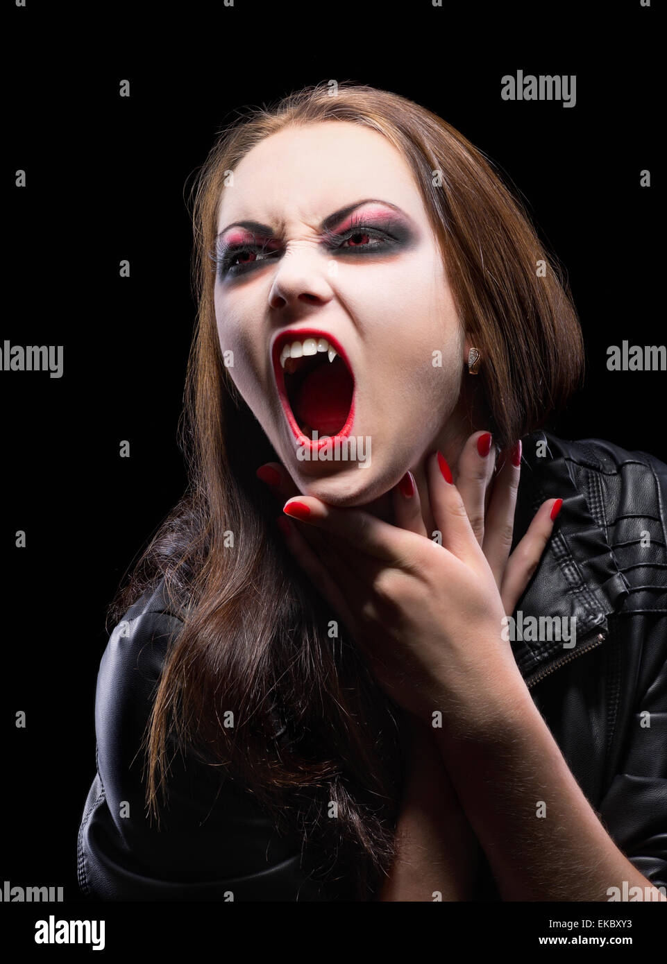 Young vampire girl isolated - Stock Image