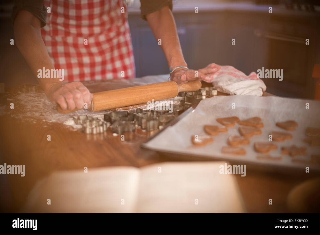 Rolling cinnamon and honey dough to make homemade cookies - Stock Image
