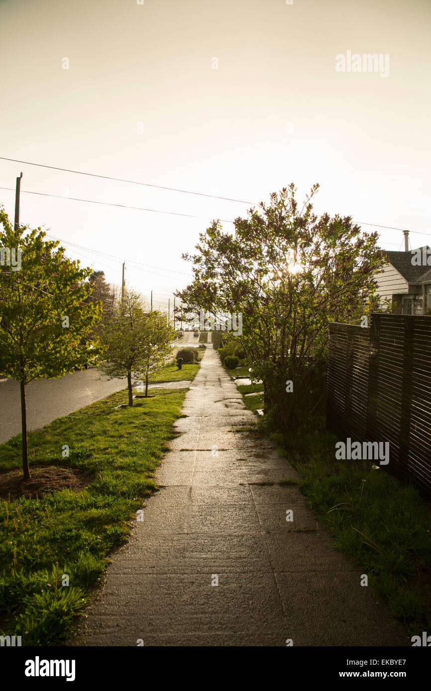 Pedestrian path along residential street - Stock Image