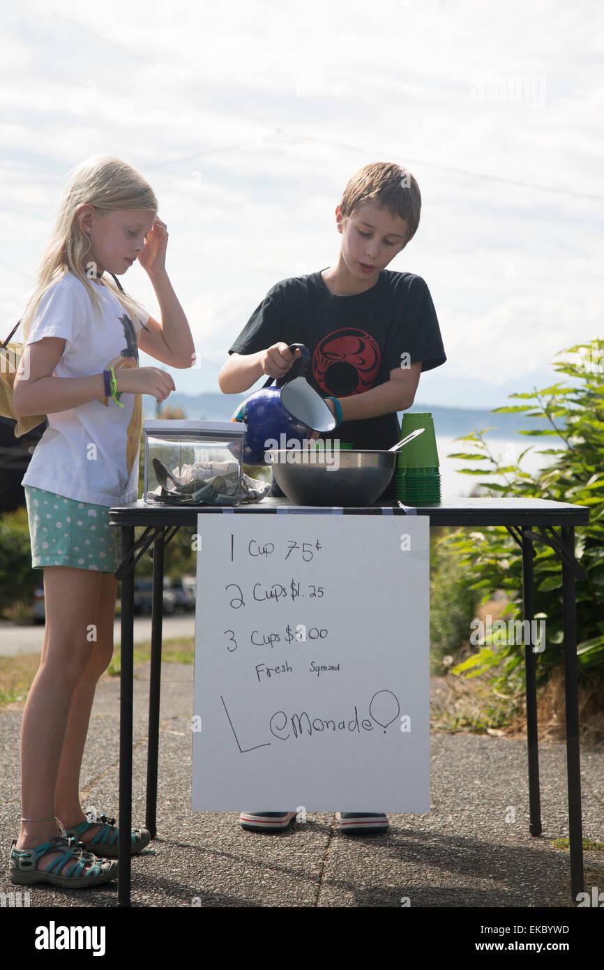 Children selling lemonade Stock Photo