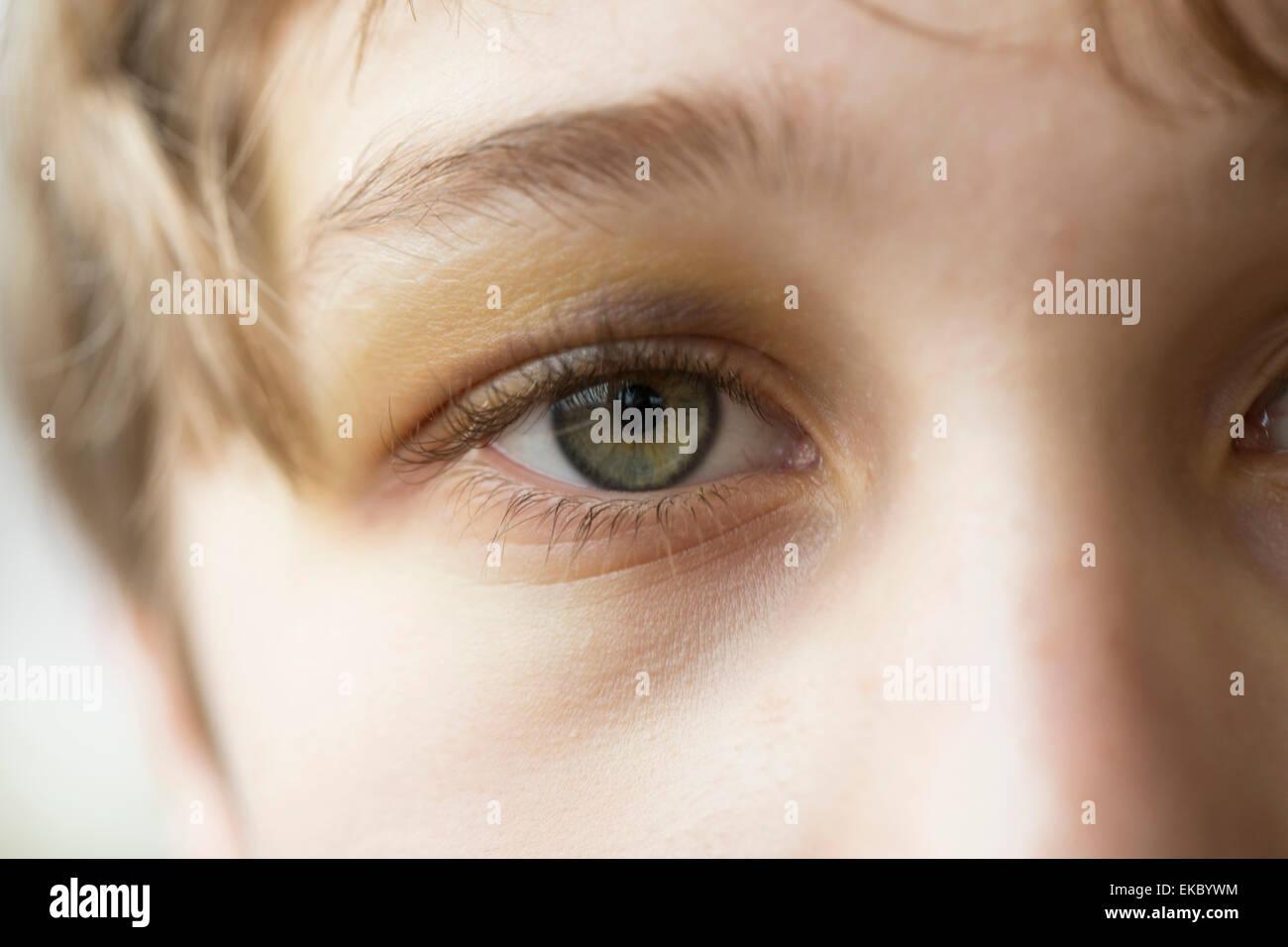 Close up of boy's eye - Stock Image