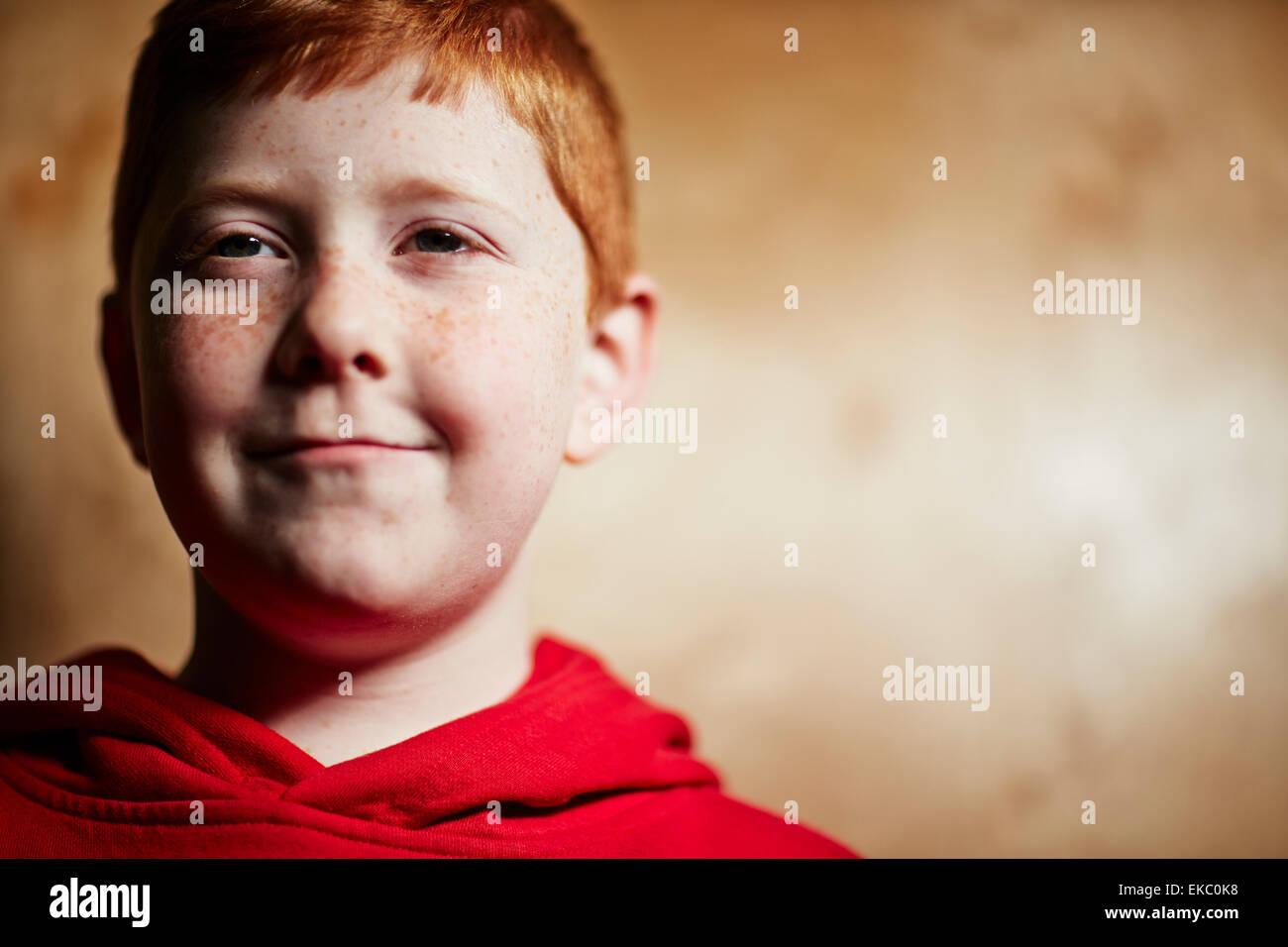 Boy with red hair, smiling - Stock Image