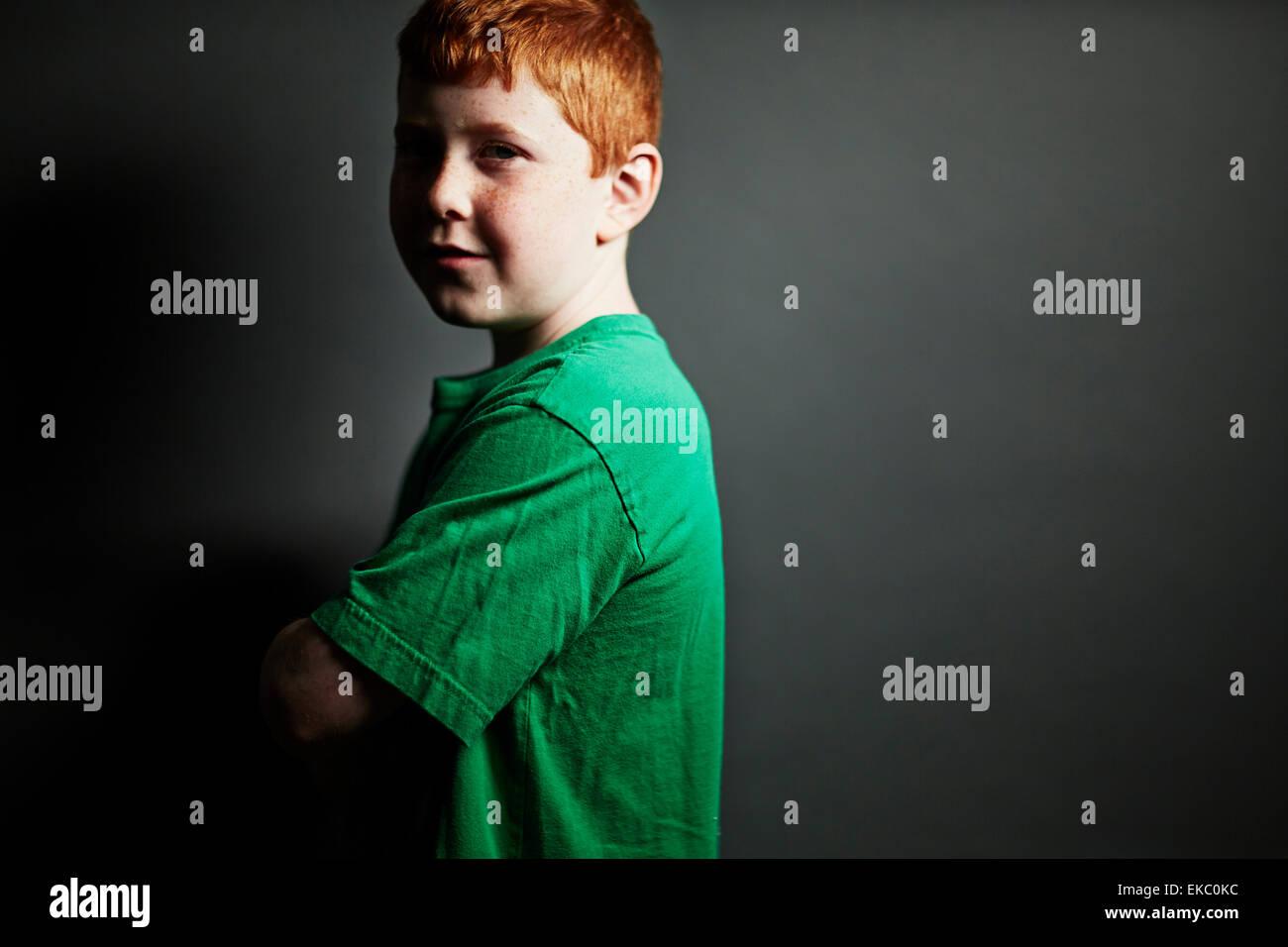 Boy wearing green t shirt - Stock Image