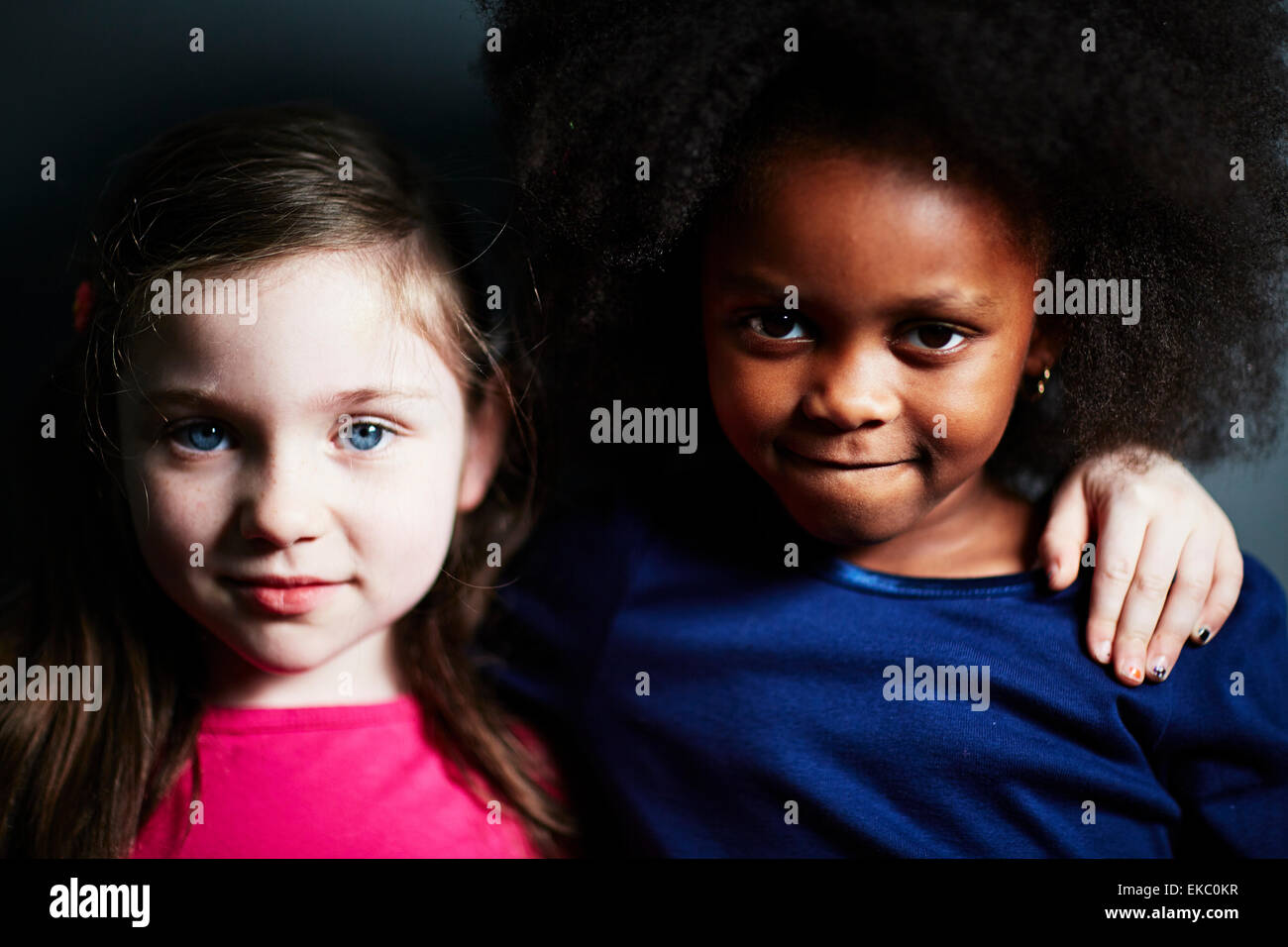 Best friends with arm around each other - Stock Image