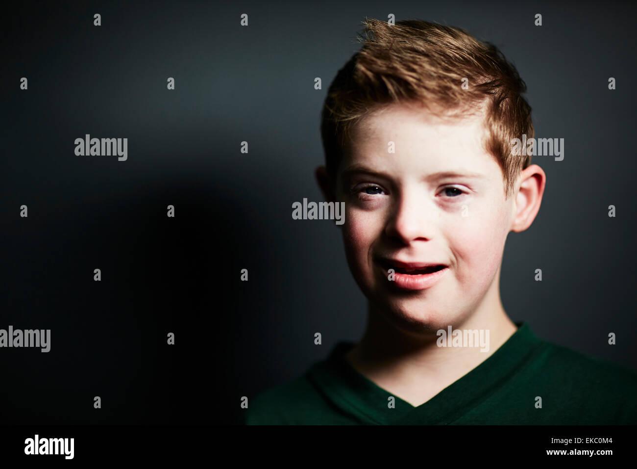 Boy looking at camera - Stock Image