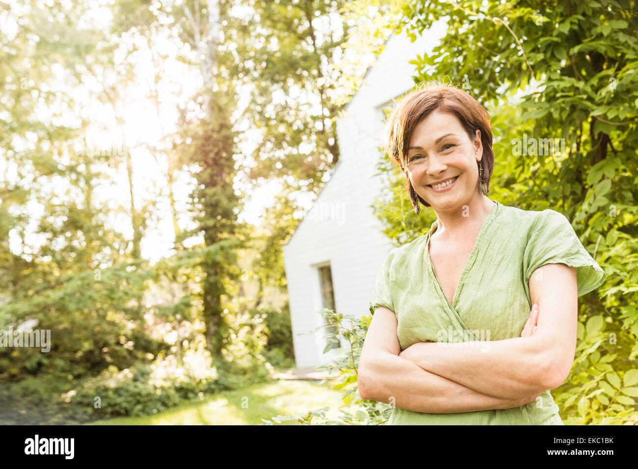 Portrait of smiling mature woman - Stock Image