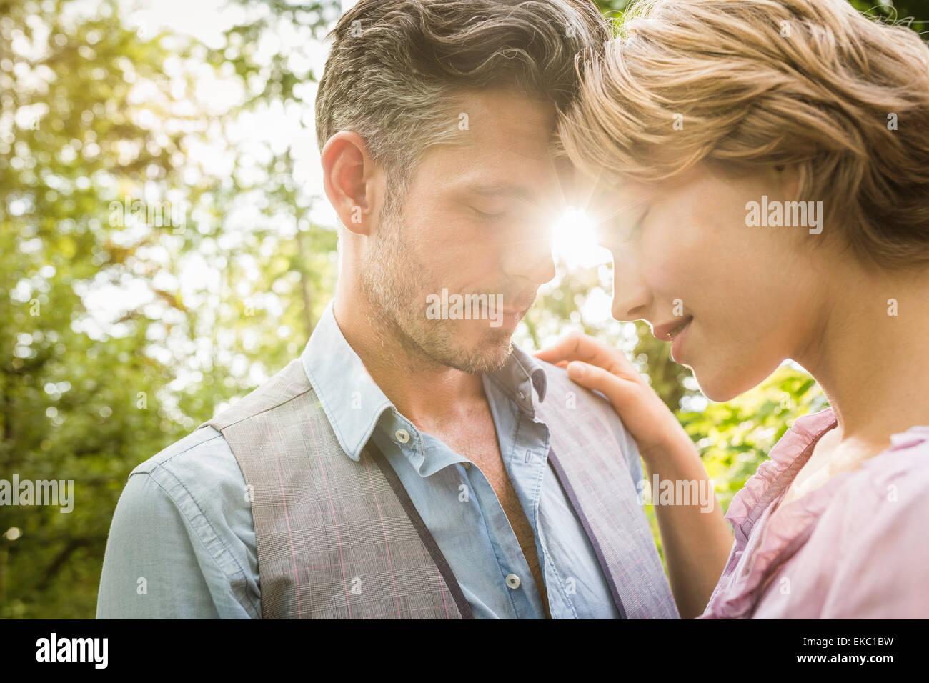 Couple hugging in garden - Stock Image