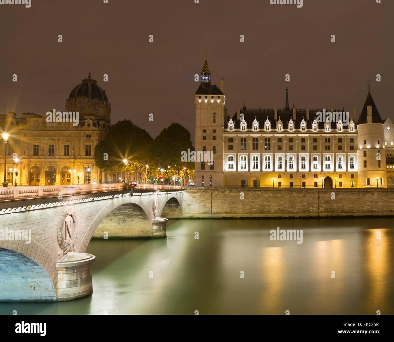 View of floodlit Musee de la Conciergerie and Pont au change at night, Paris, France - Stock Image