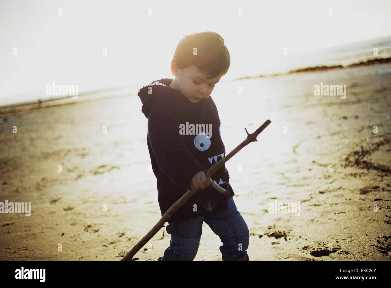 Boy on Troon Beach, Ayrshire, Scotland - Stock Image