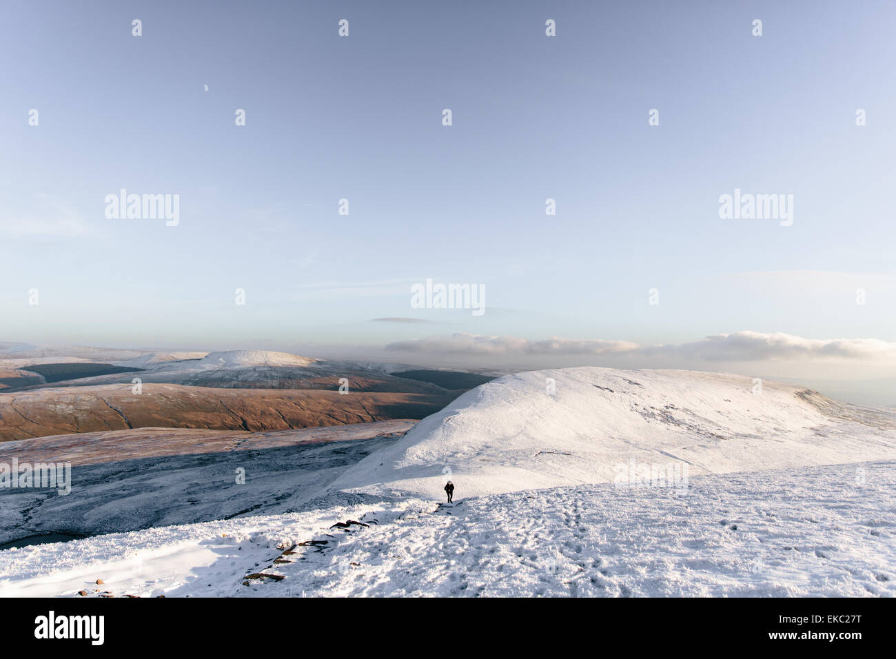 Person hiking in distance, Llyn y Fan Fach, Brecon Beacons, Wales - Stock Image