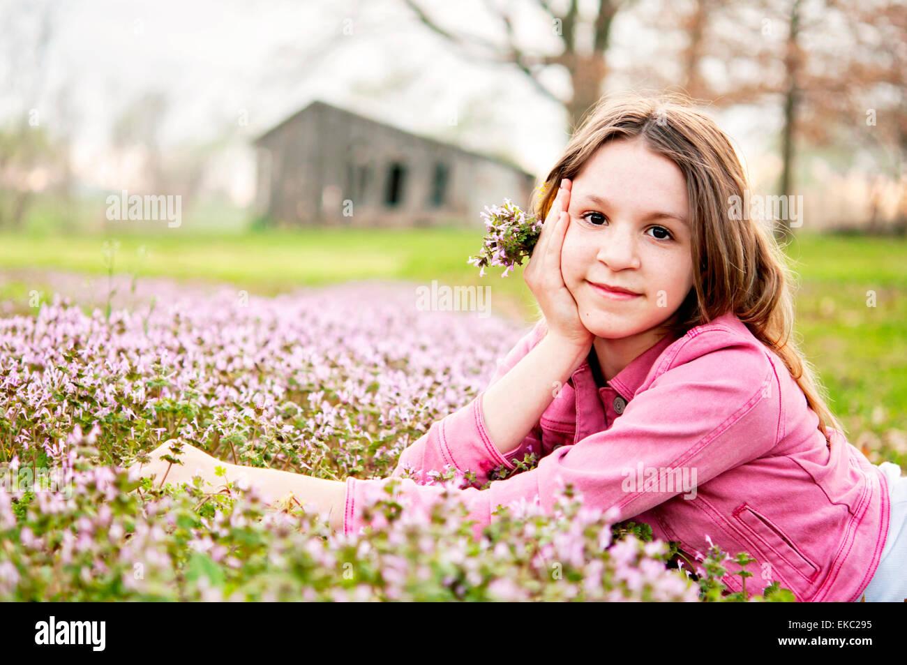 Girl Spring portrait flowers - Stock Image