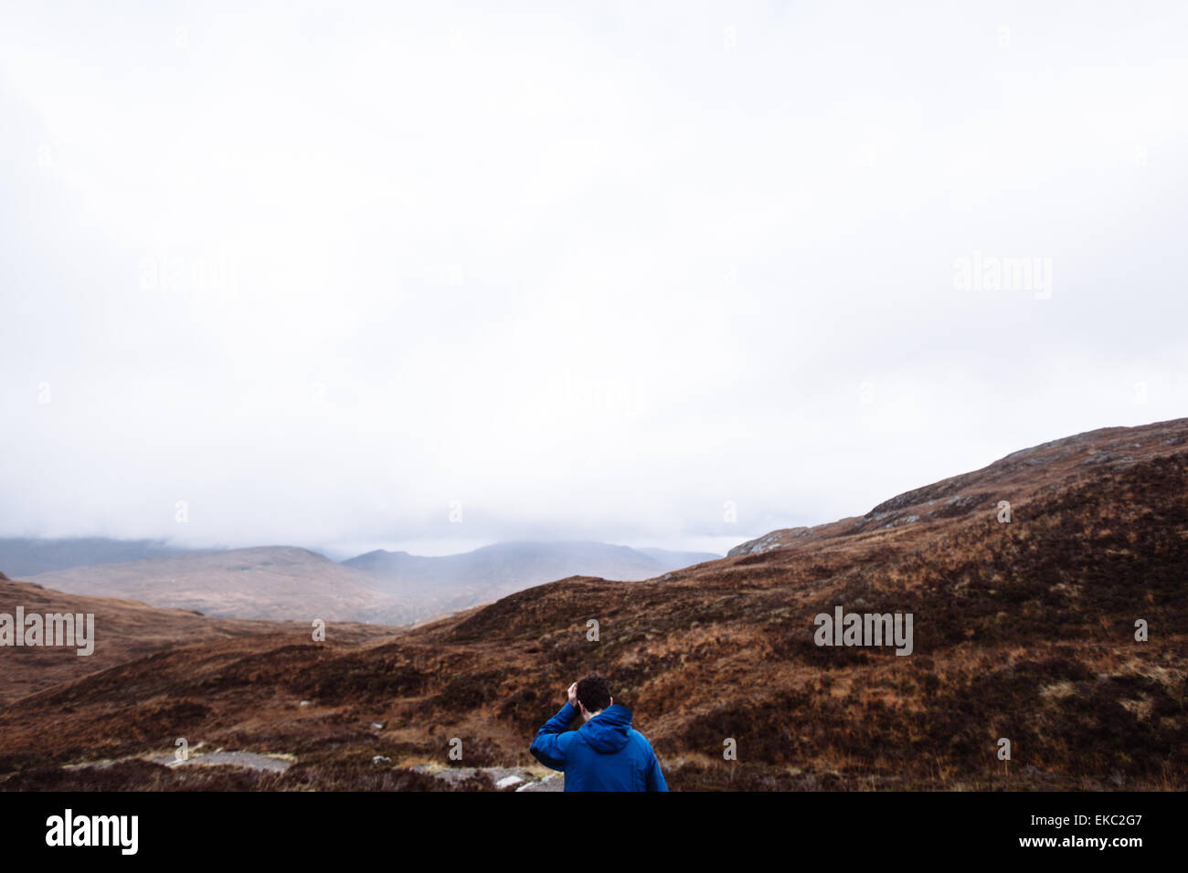 Man hiking, Glencoe, Scottish Highlands, Scotland - Stock Image
