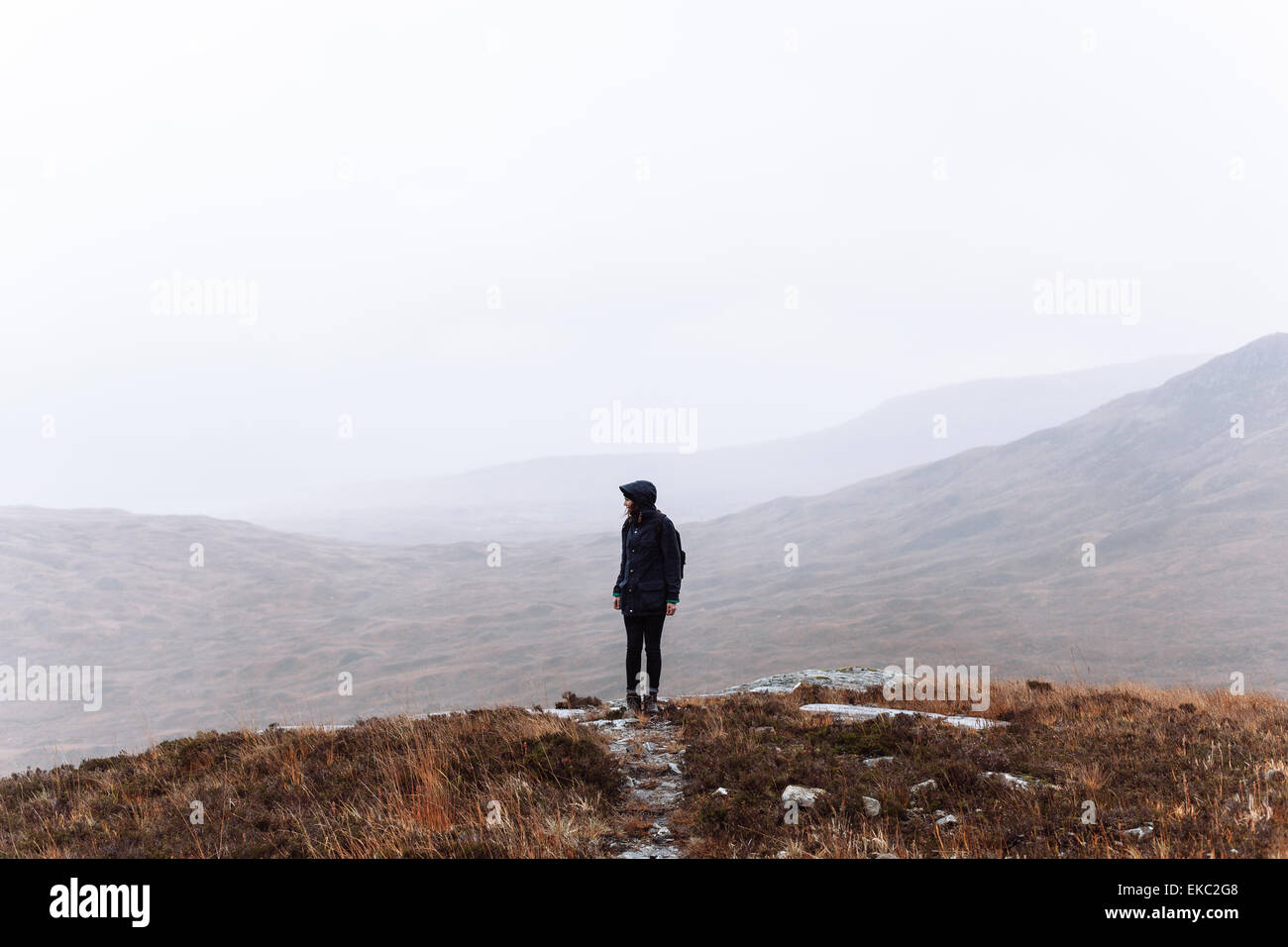 Woman hiking, Glencoe, Scottish Highlands, Scotland - Stock Image