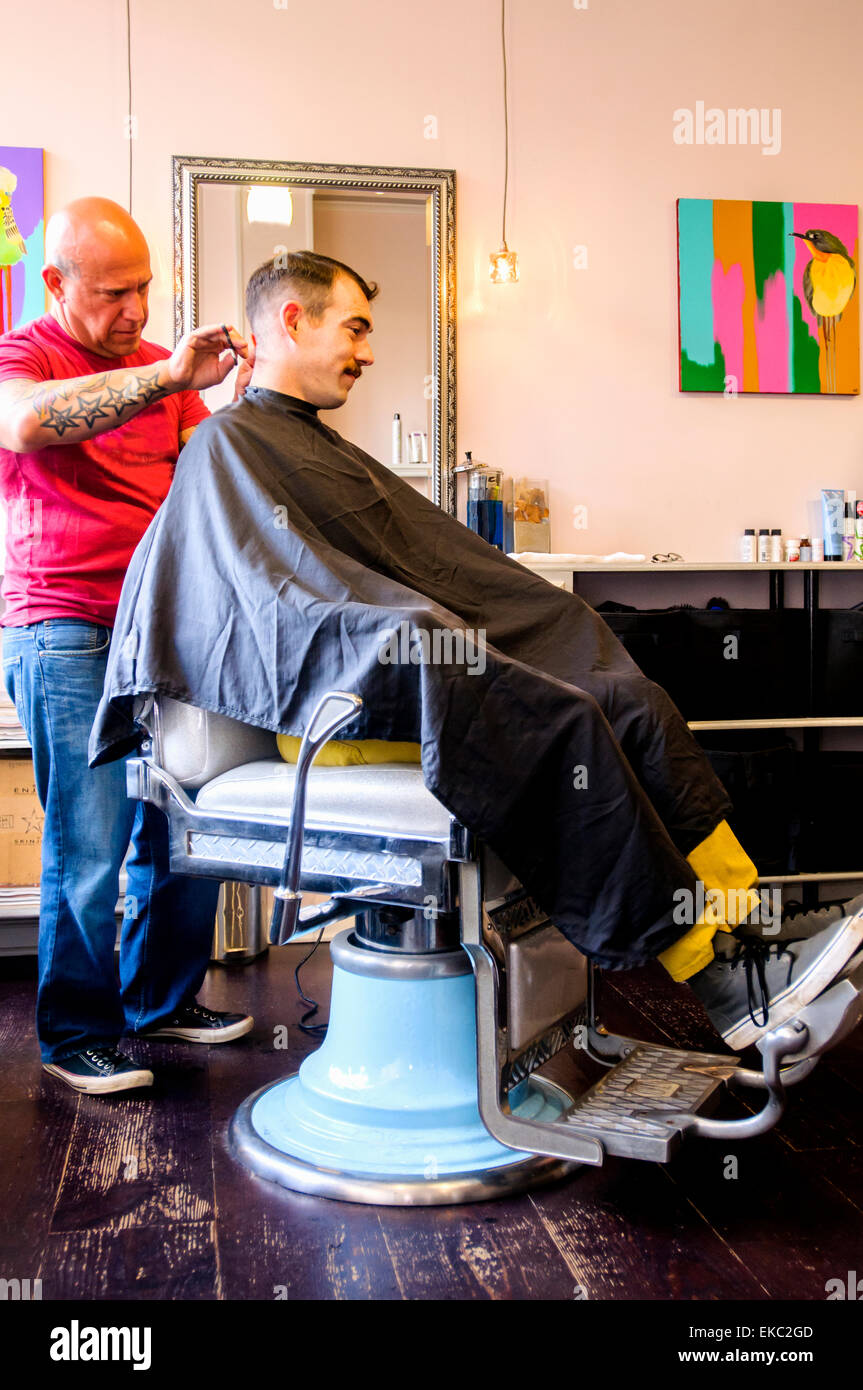 Young man having his hair cut Stock Photo