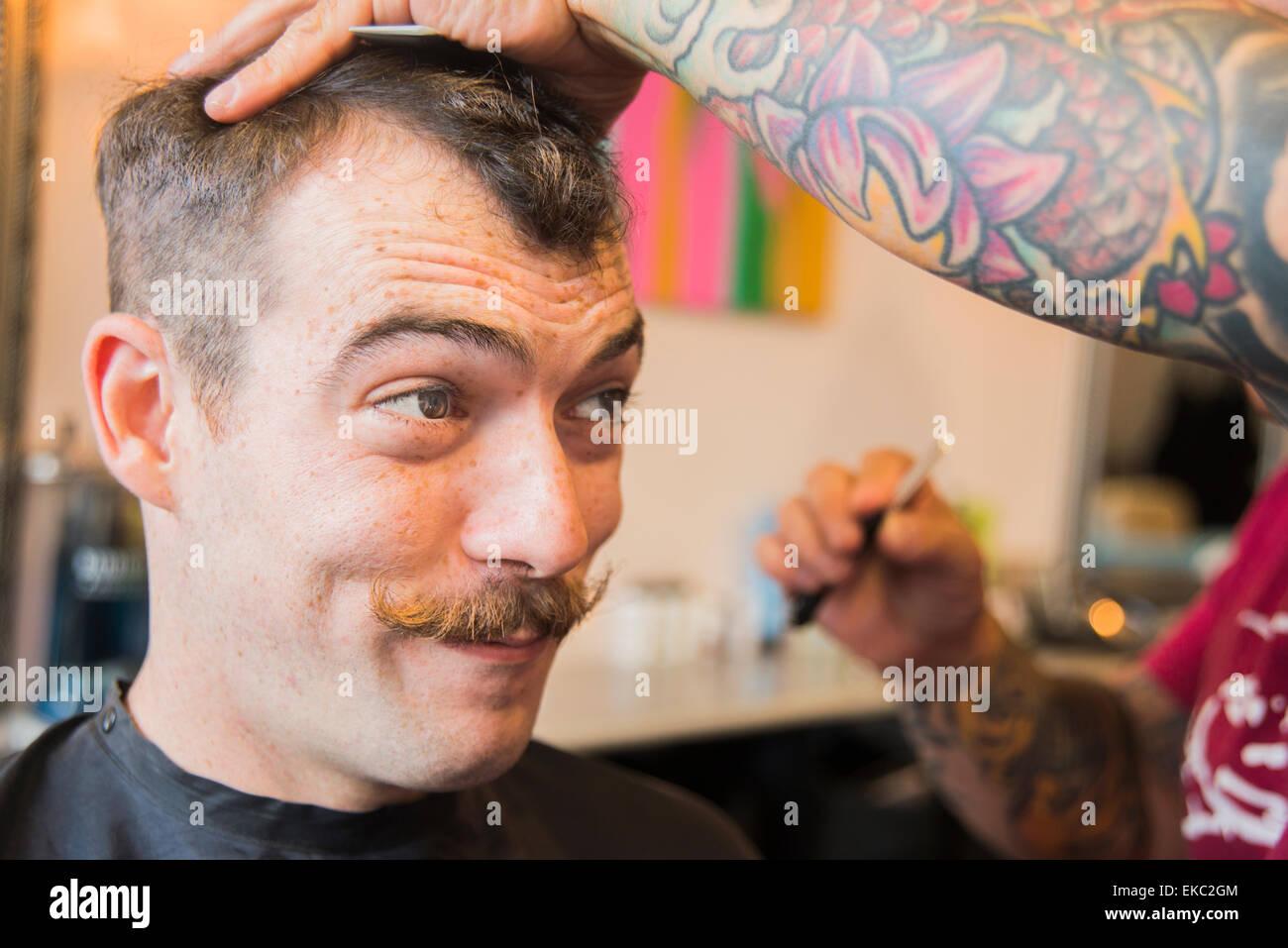 Young man having his hair cut - Stock Image