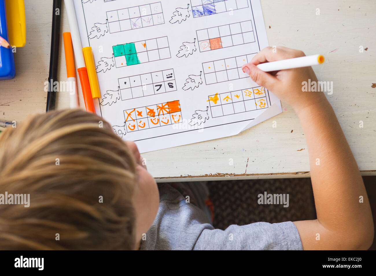 Young boy doing homework, high angle - Stock Image