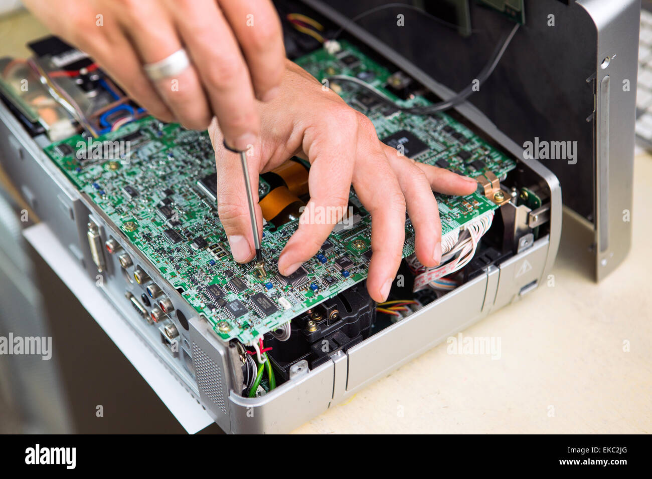 Man repairing circuit board, close up - Stock Image