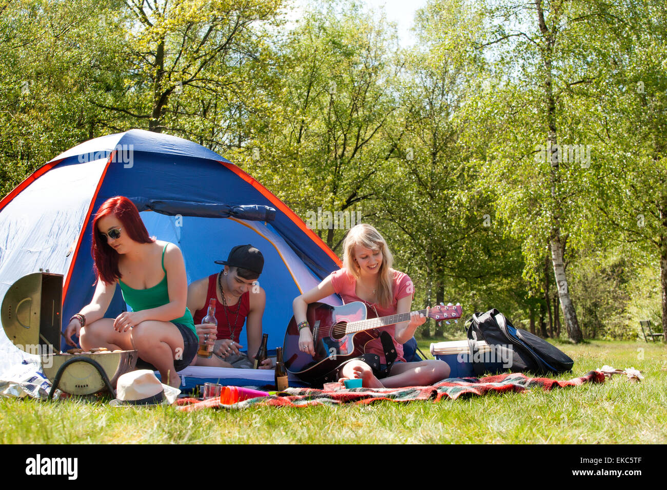 Young teenagers having a nice time on the camping - Stock Image