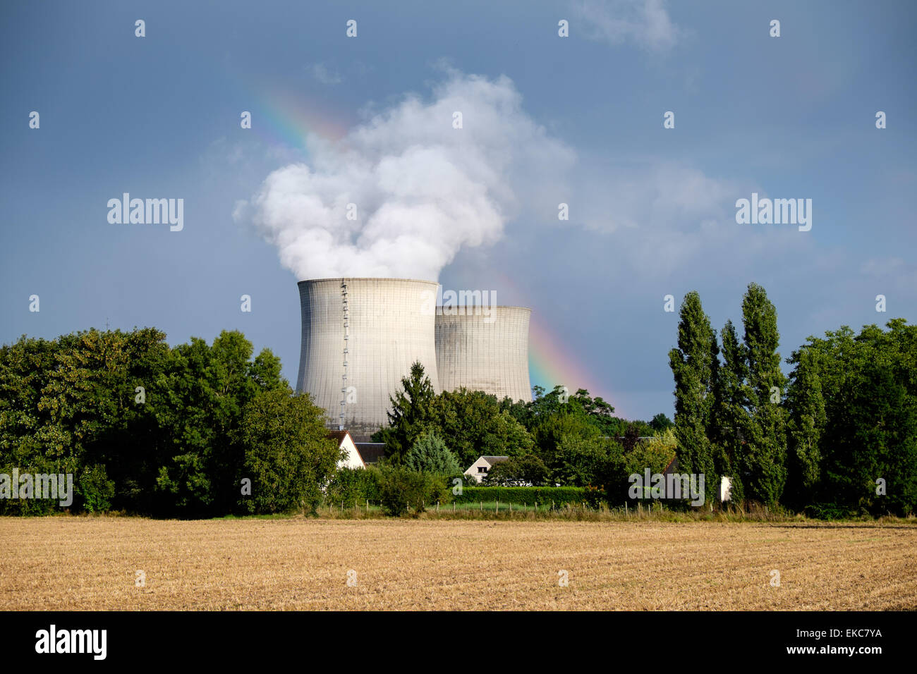 View from village of Avaray of rainbow and cooling towers of Saint-Laurent Nuclear Power Station on the Loire river - Stock Image