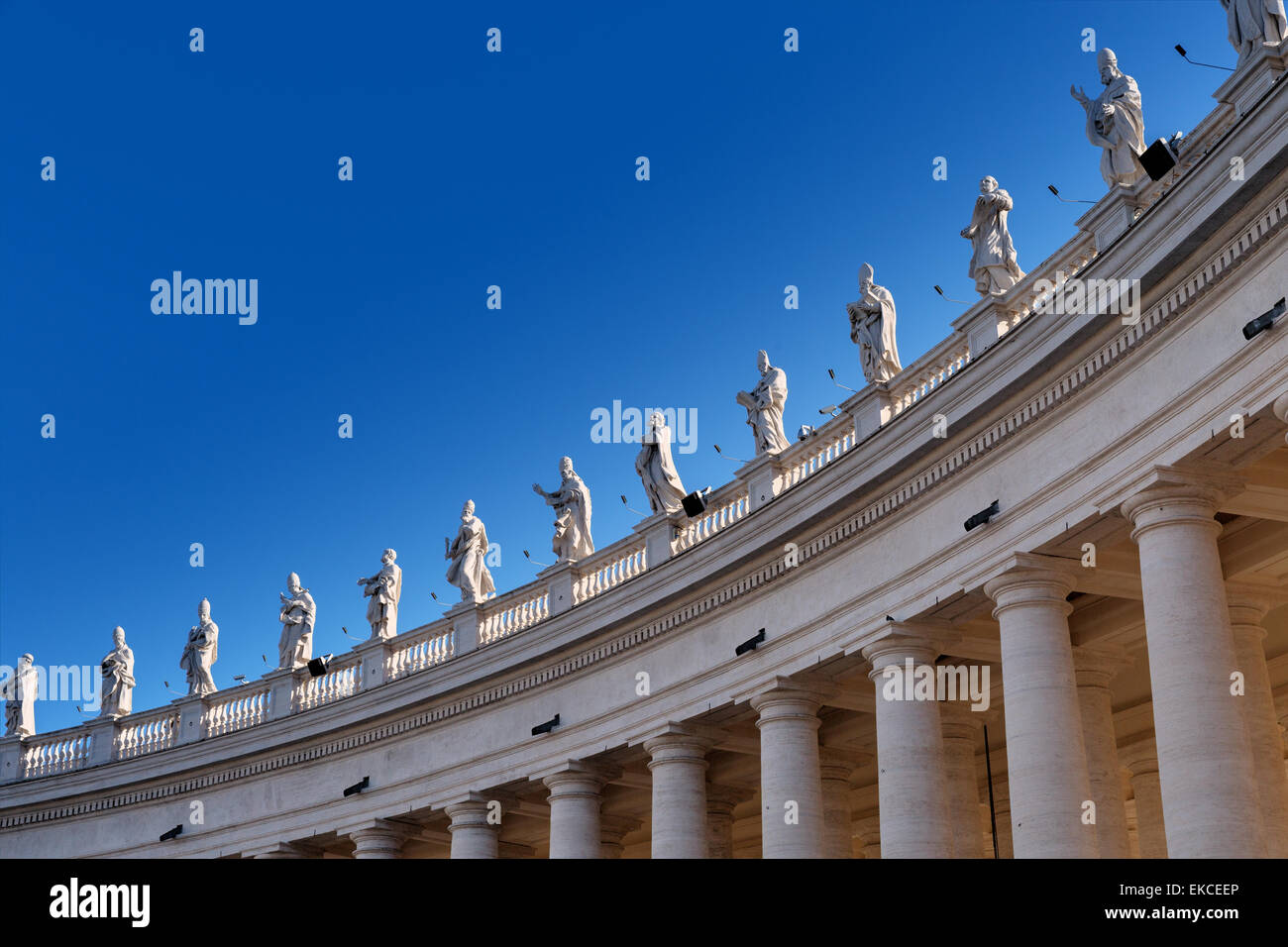 View of the top of the colonnade at St. Peters Tomb with statues of saints - Stock Image