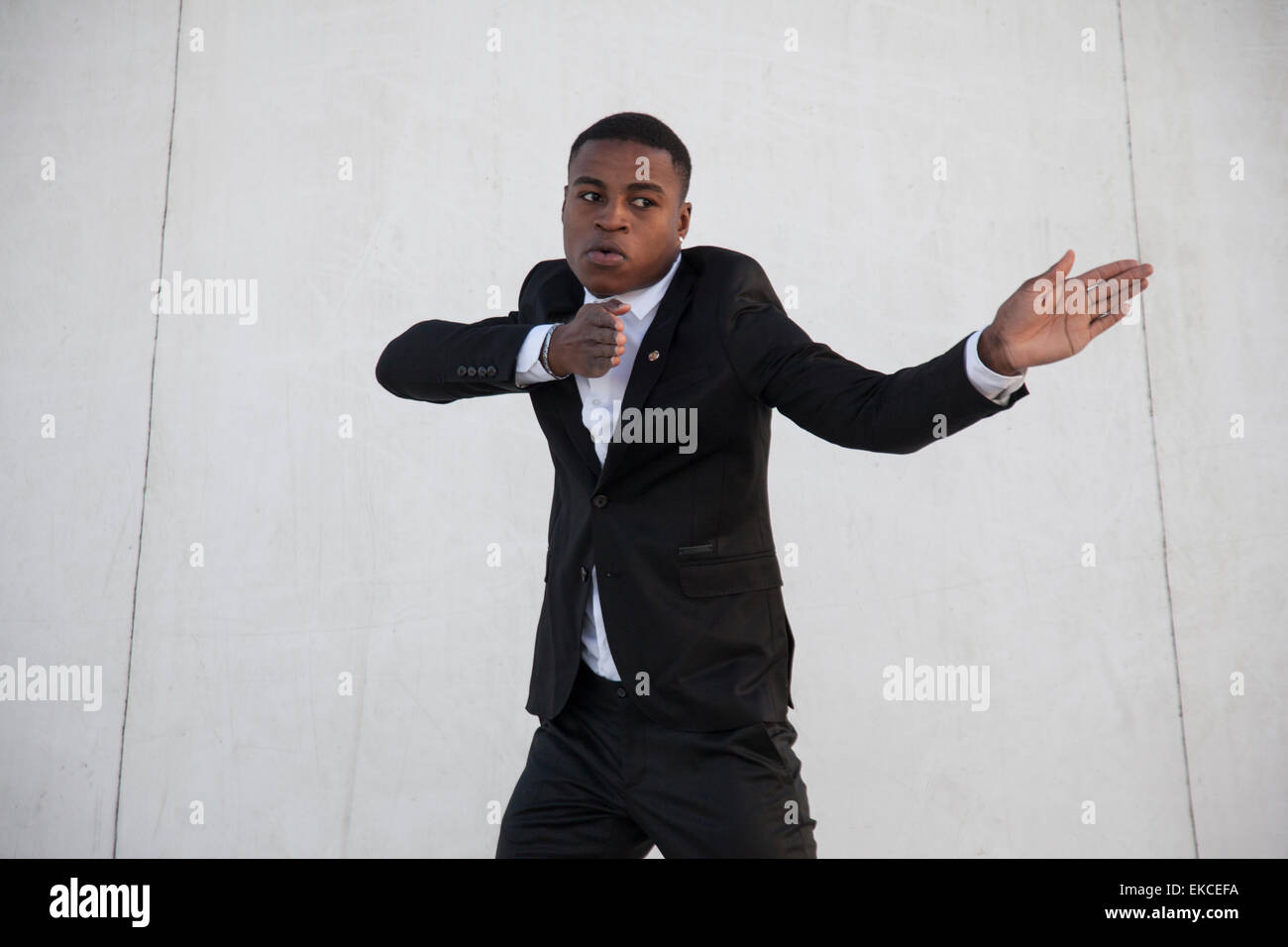 Young man in a suit street dancing - Stock Image