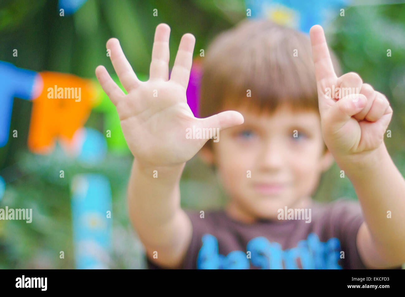 Birthday boy showing the number six with his hands - Stock Image