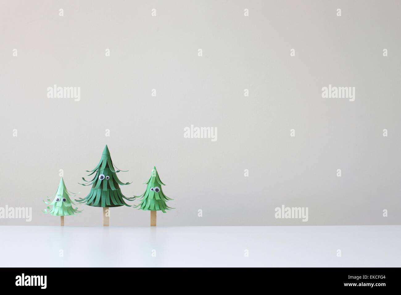 Conceptual trees with googly eyes - Stock Image