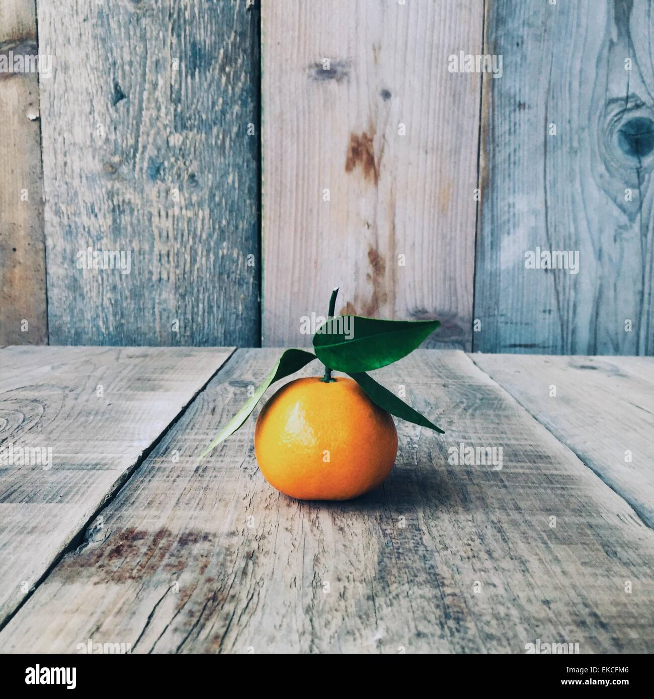 Tangerine on a wooden table - Stock Image