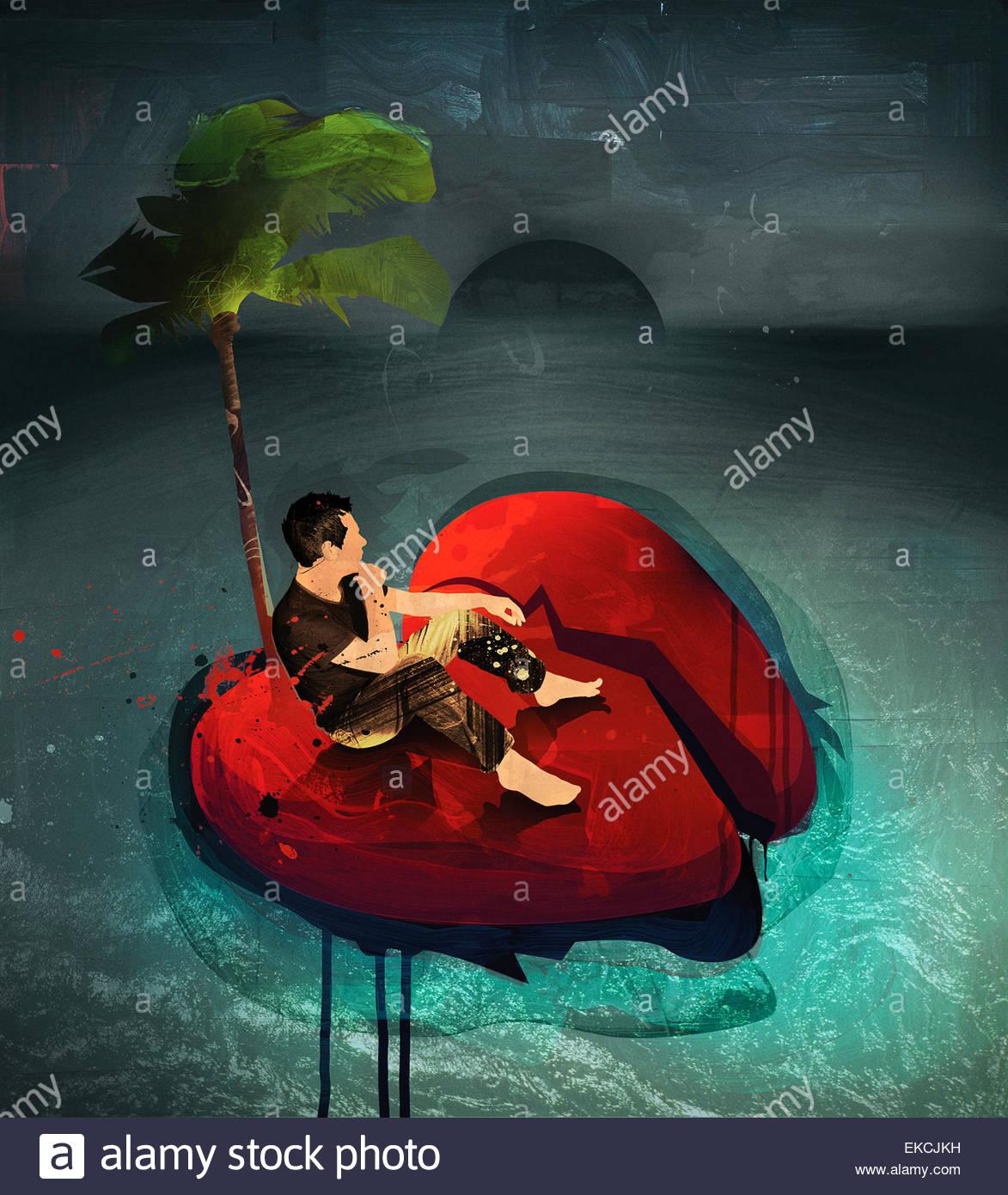 Man on stranded broken heart island - Stock Image