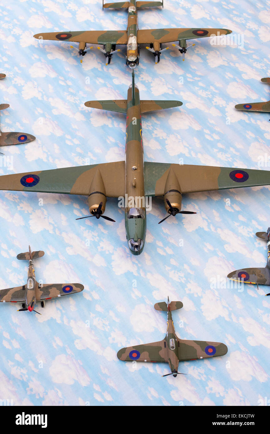 WW2 British Airfix model army planes on a sky cloud material background - Stock Image