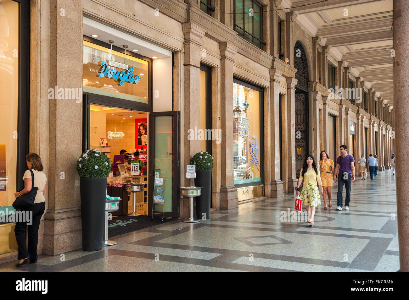 Turin shopping arcade, view of people walking under a colonnade in the luxury retail district of the Via Roma, Turin, - Stock Image